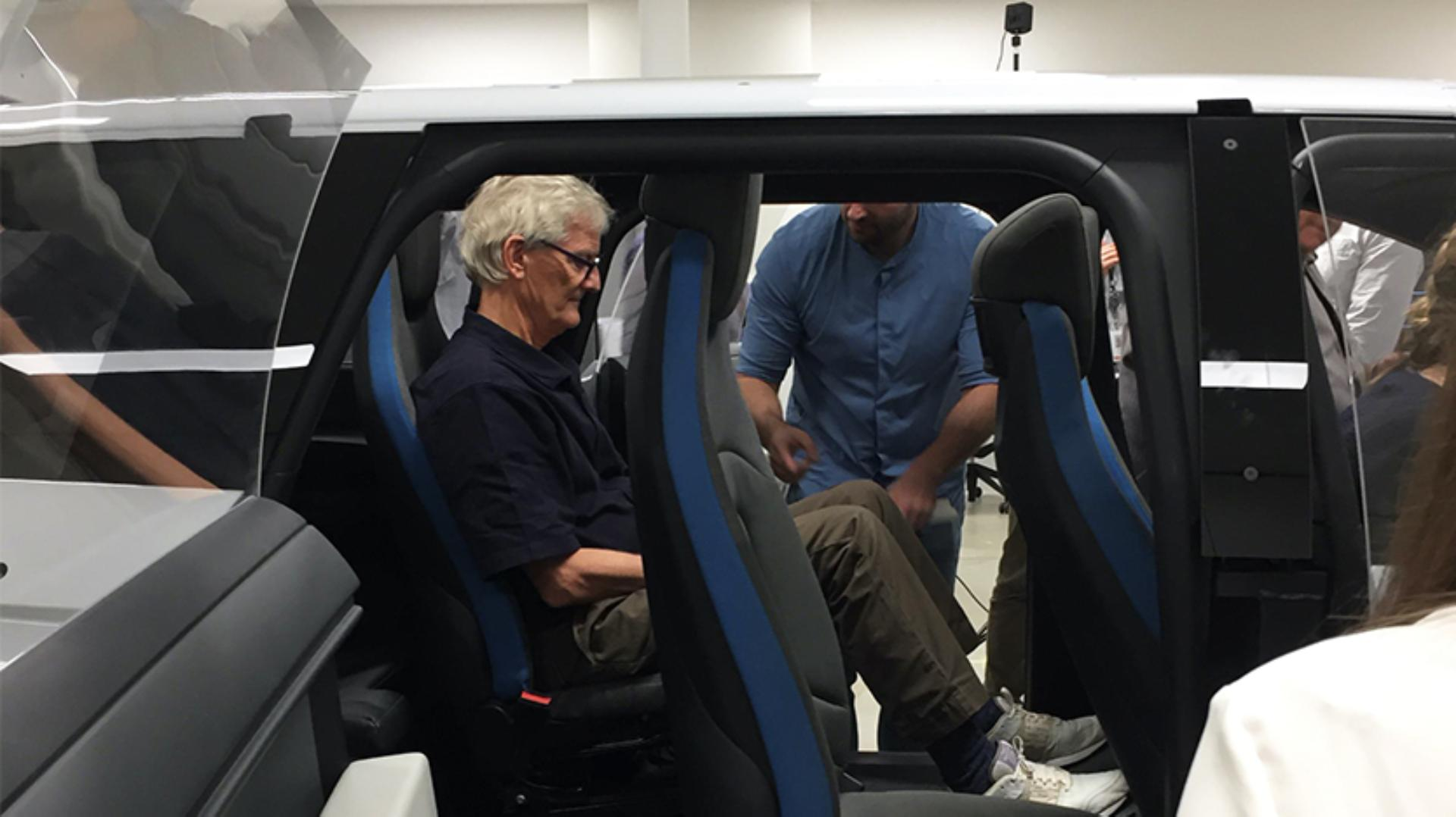 Profile view of James Dyson sitting in a test car frame