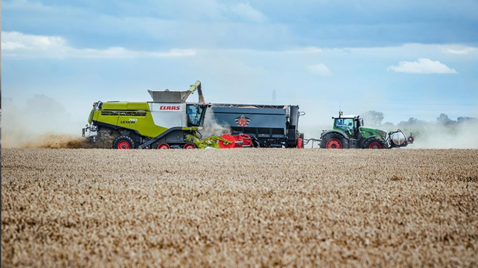 Side view of wheat being harvested