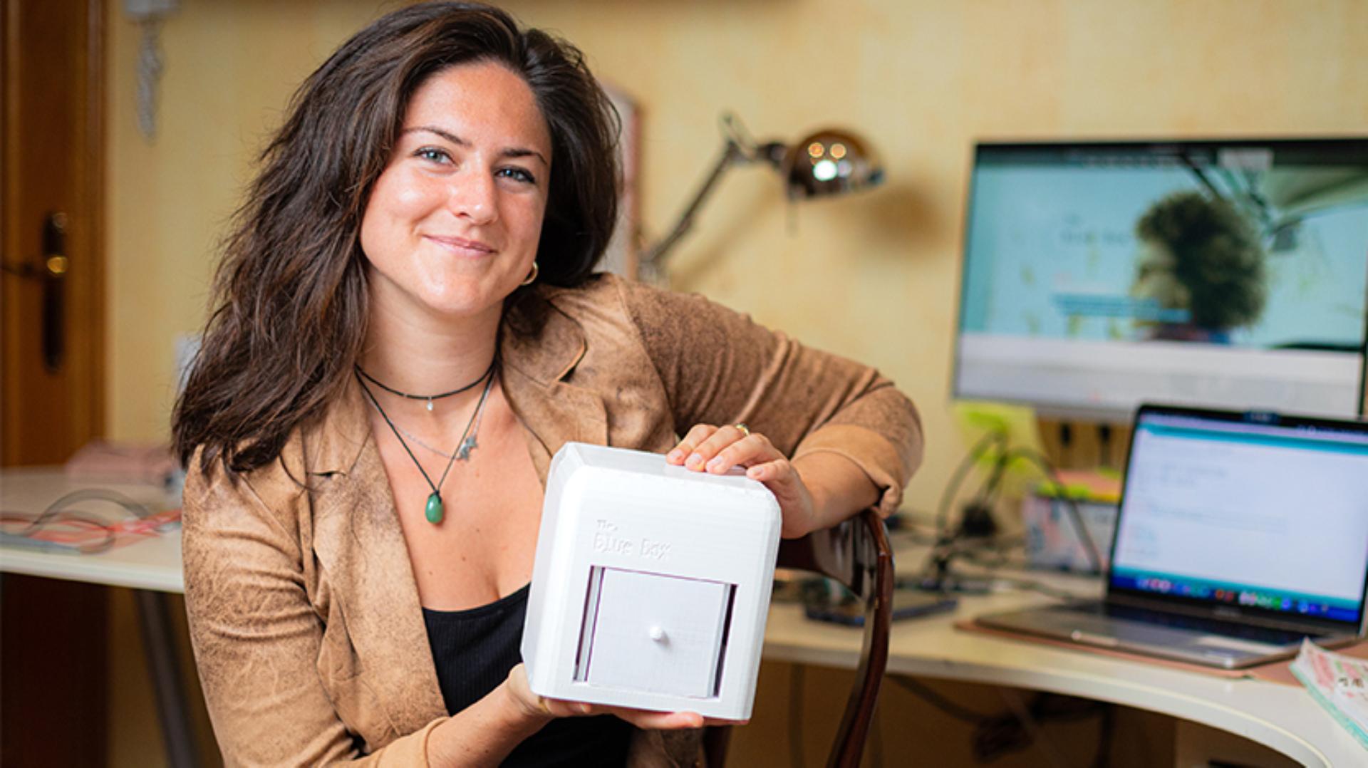 Judit Giro Benet holding her 'Blue Box' entry