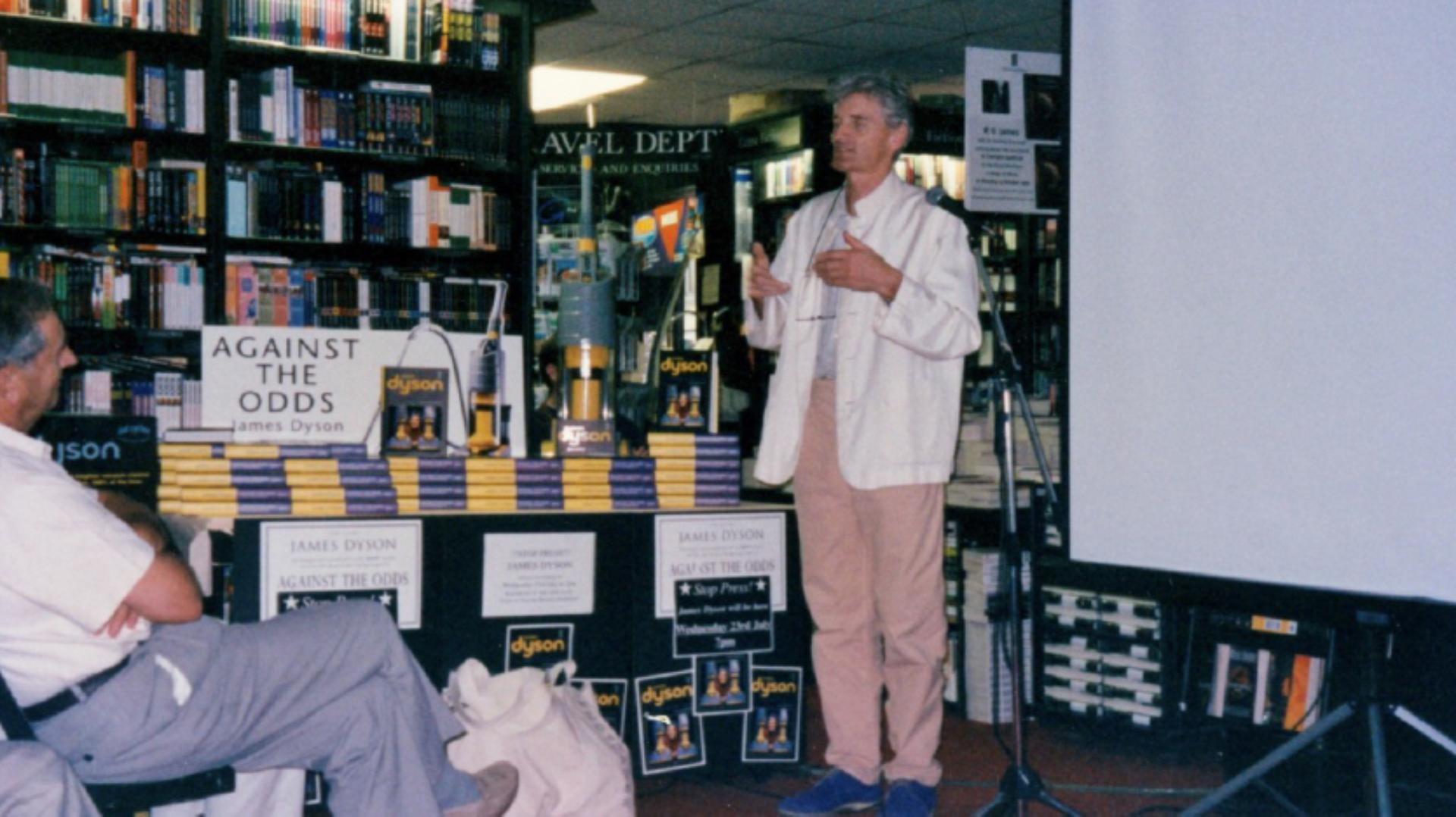 James Dyson standing in a book store