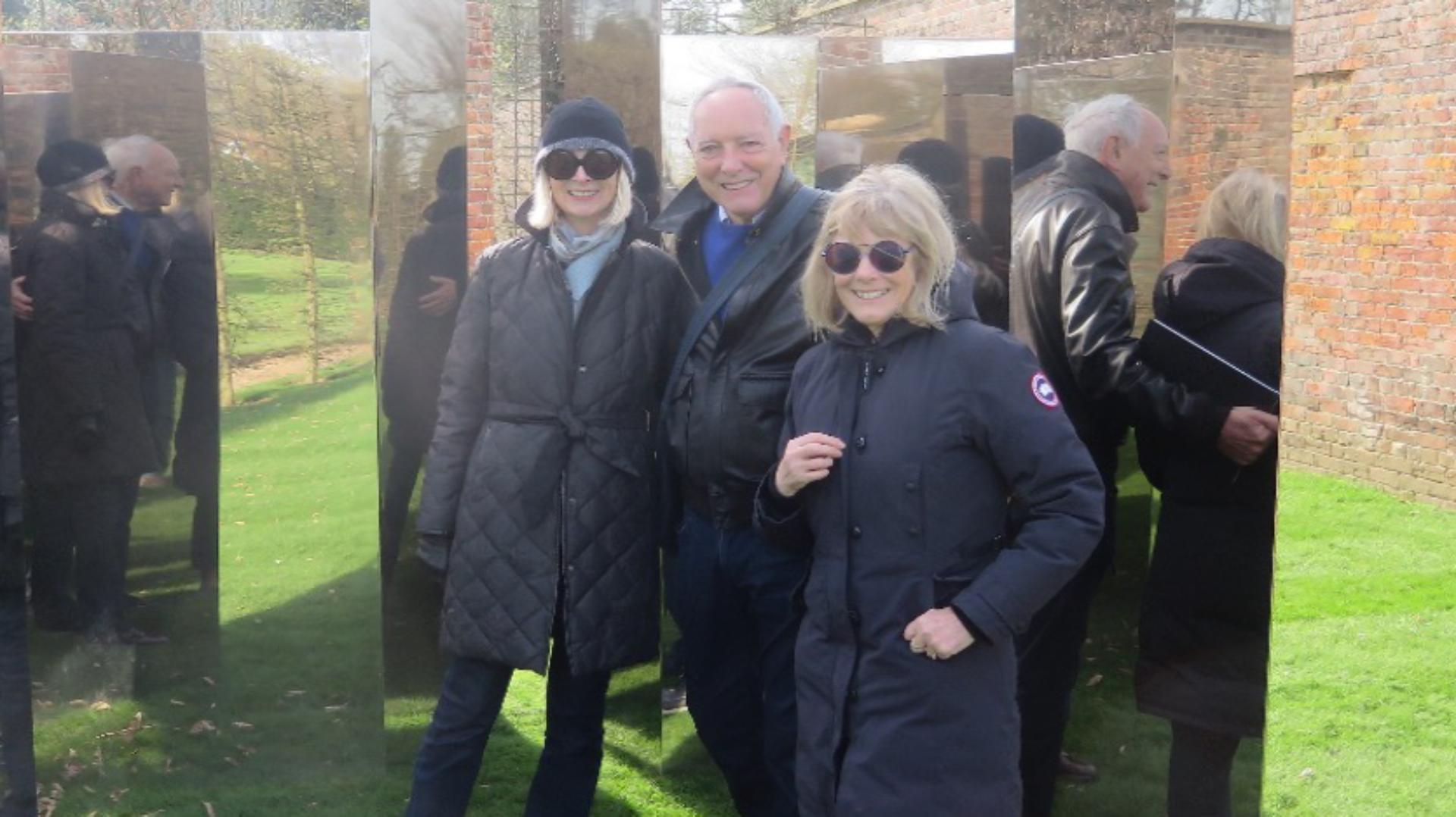 Deirdre Dyson standing with Chris and Diana Wilkinson