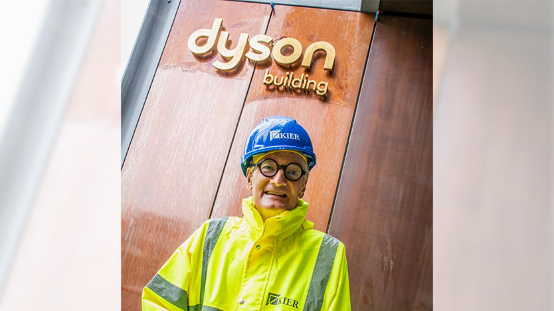 James Dyson standing in front of the Dyson building at Gresham school