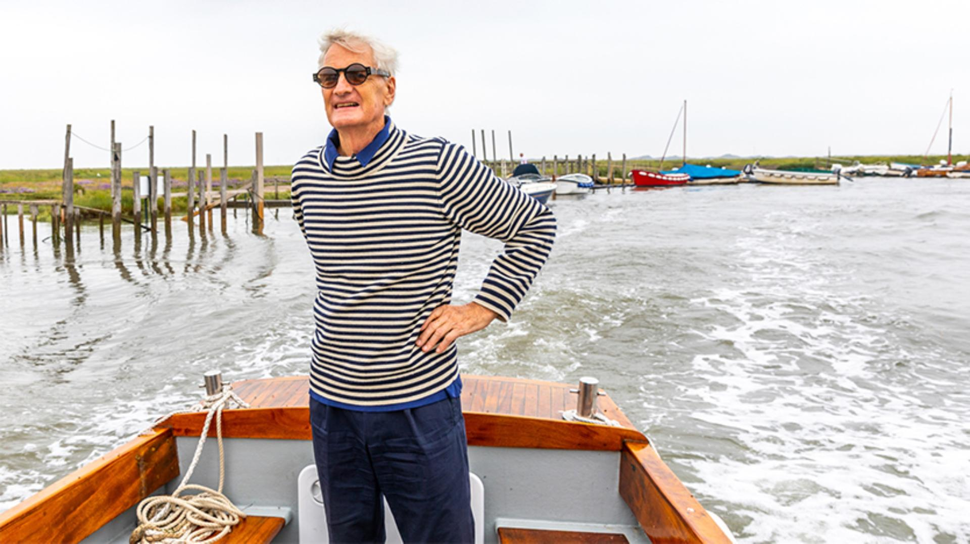 James Dyson standing on a boat at Blakeney Point
