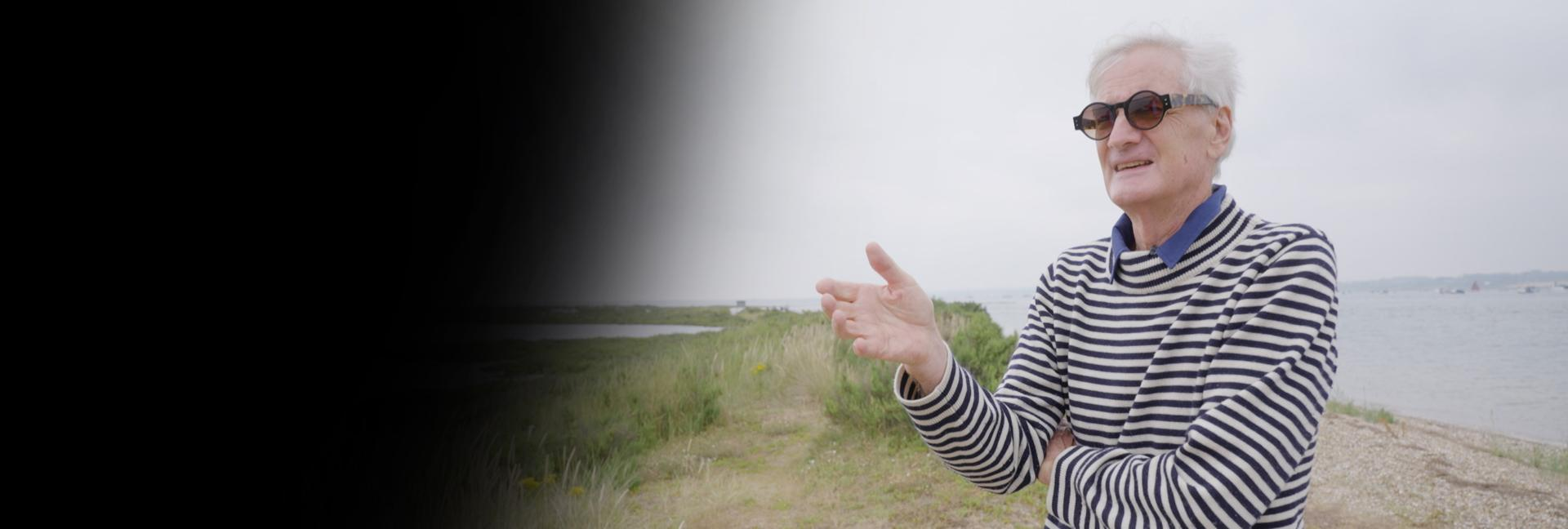 James Dyson stood explaining a story at Blakeney Point