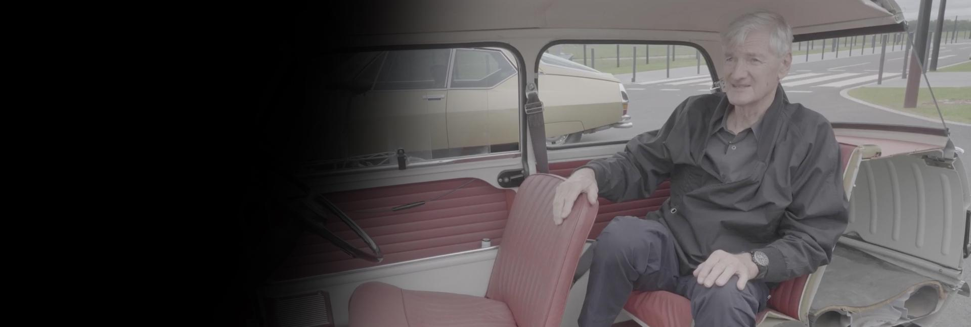 James Dyson sat in the back of old car