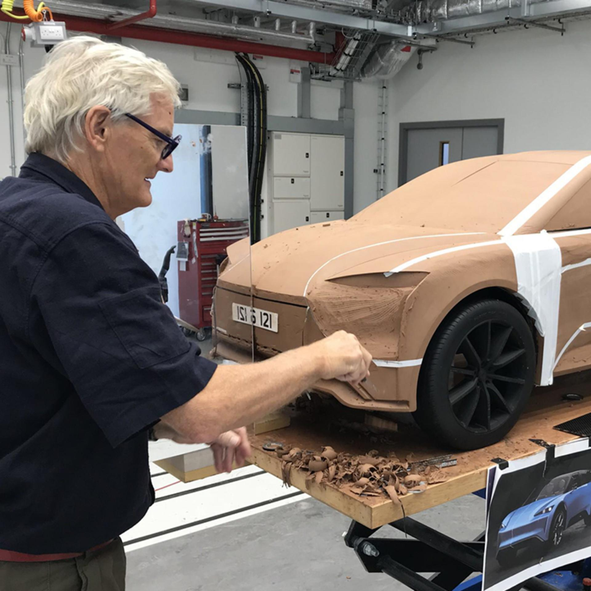 James Dyson modelling the front of the car out of clay