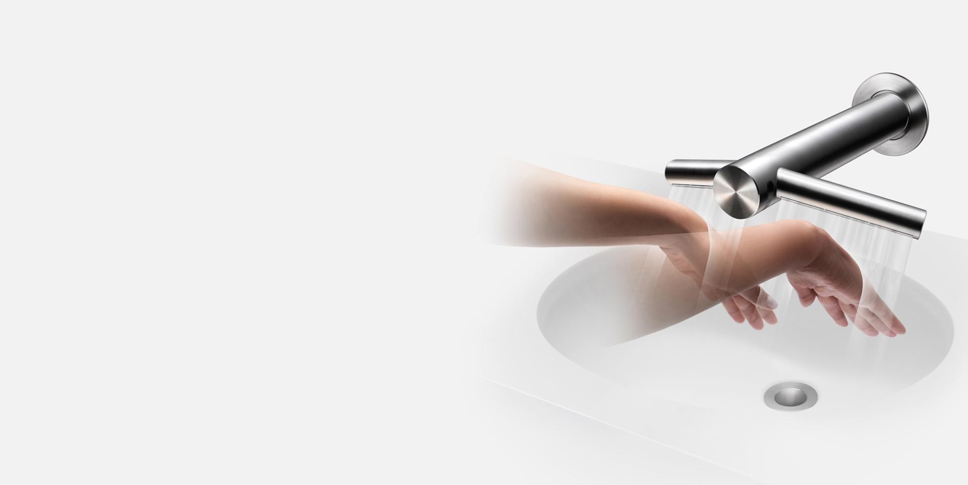 Hands beneath Dyson Airblade Wash+Dry hand dryer