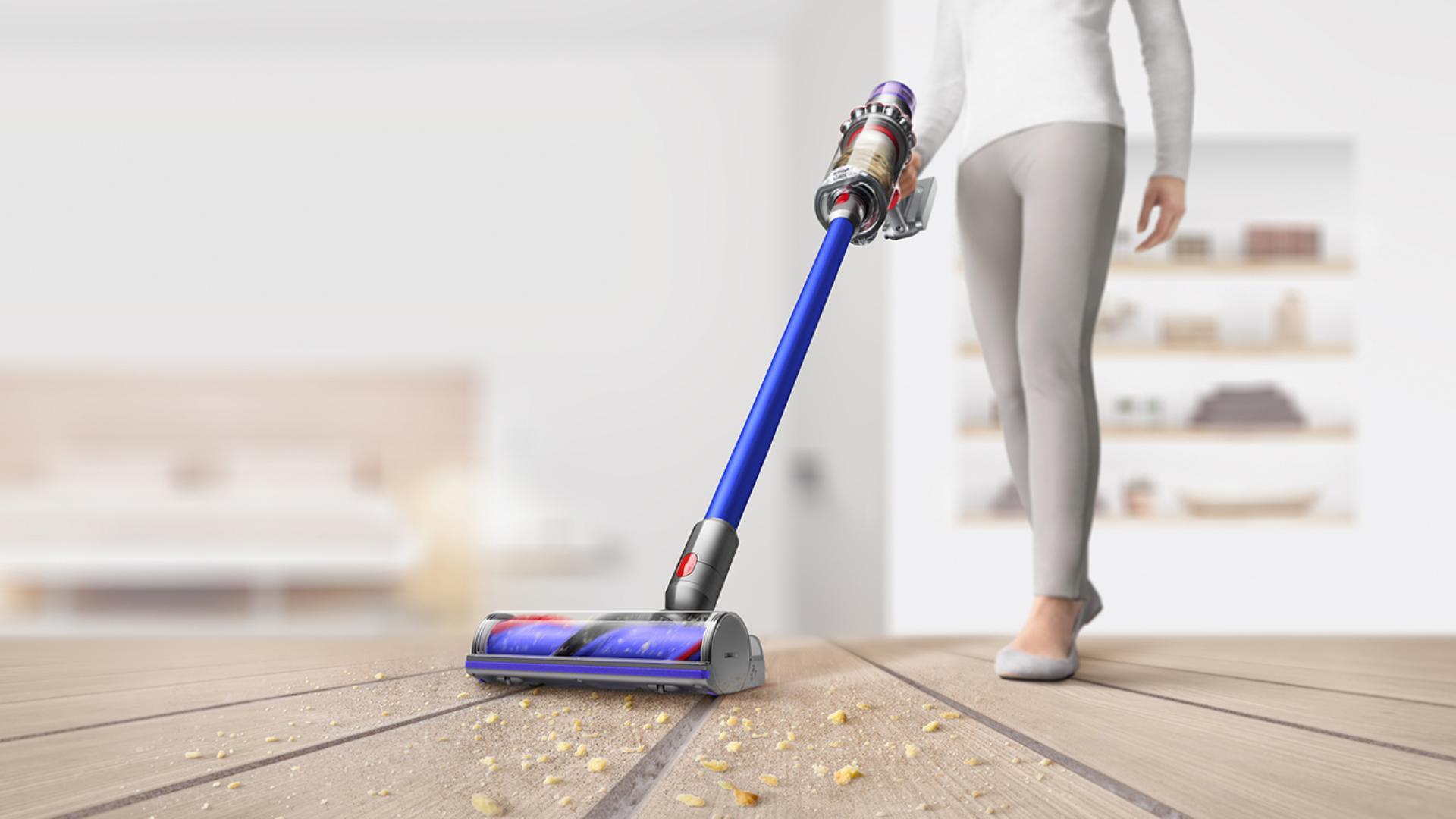 Dyson 11 vacuuming up dirt