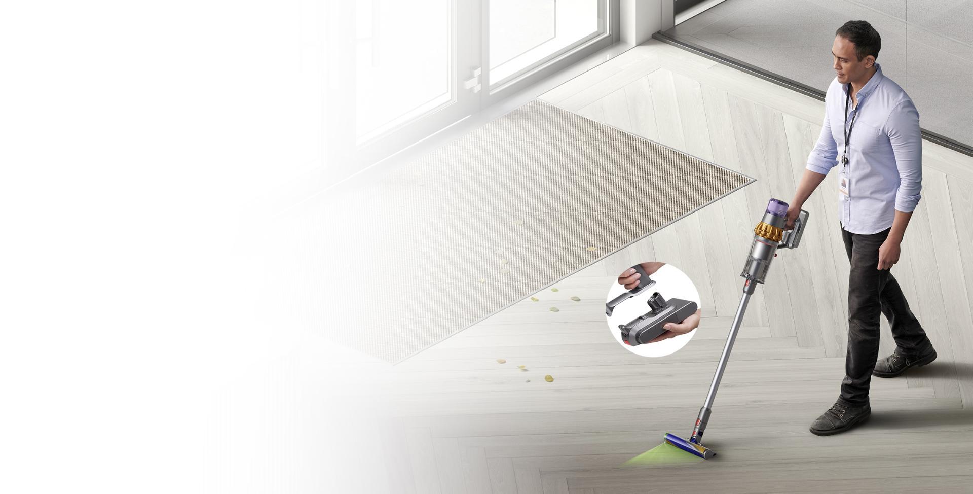 Man vacuuming hard floor with Dyson V15 Detect vacuum