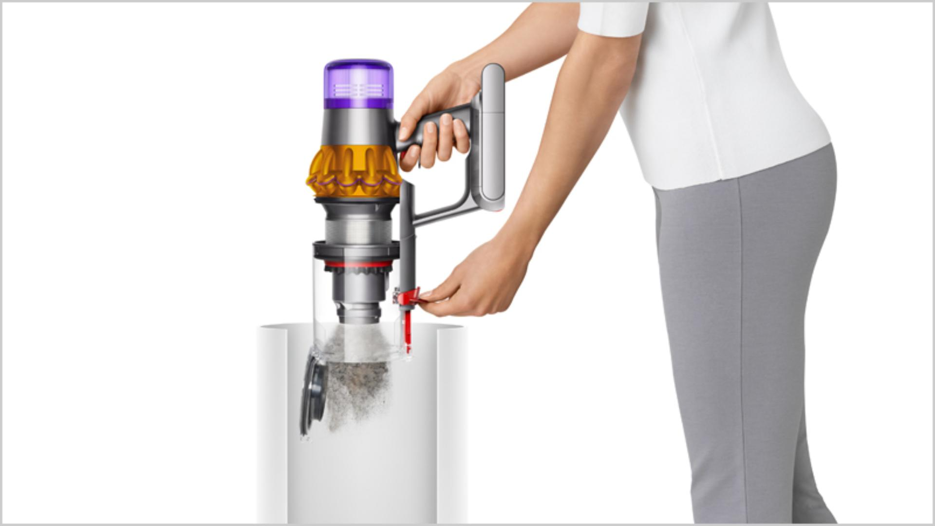 Woman emptying Dyson vacuum into the bin