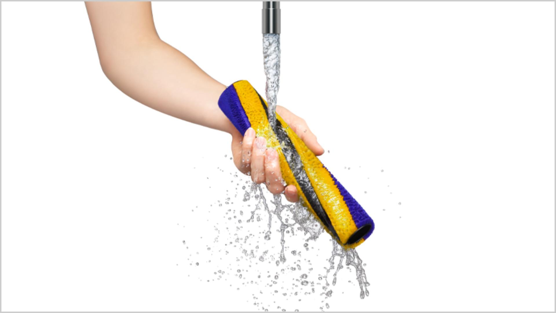 Dyson removable parts being washed in water
