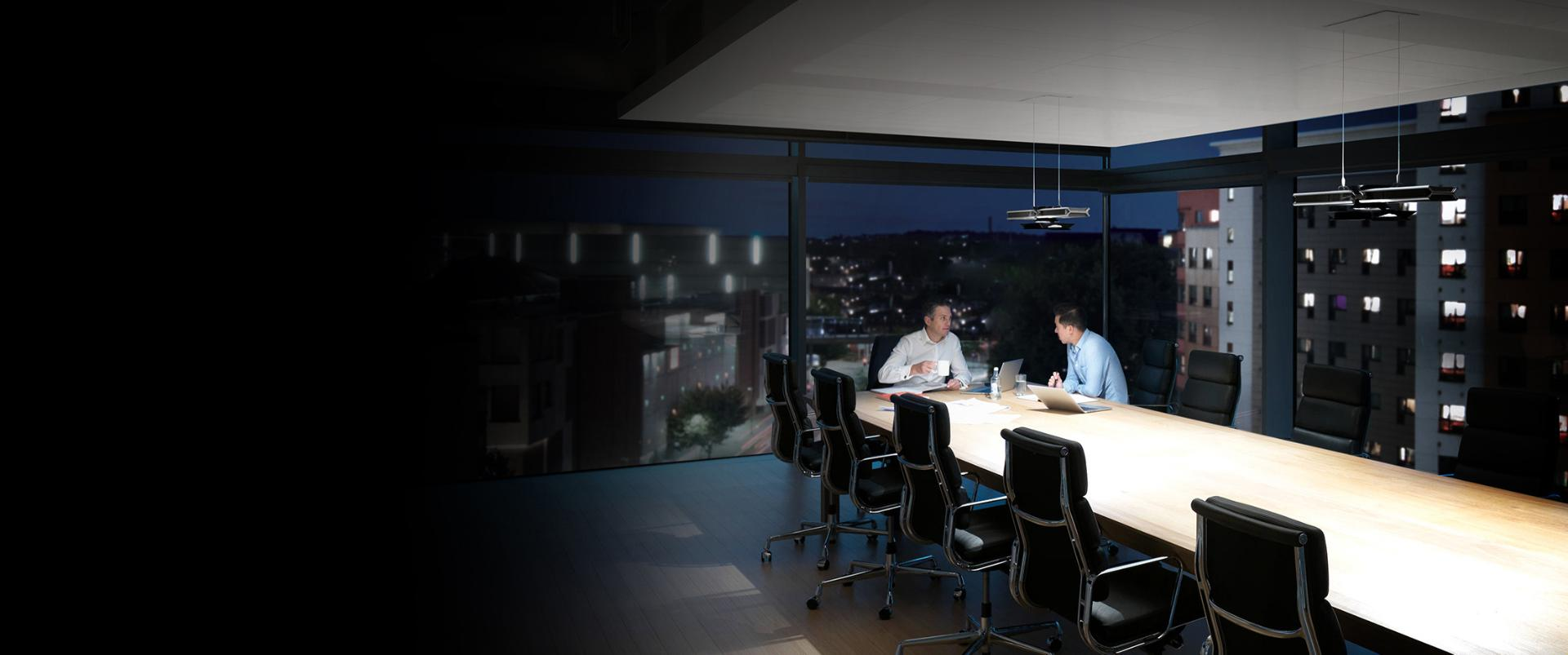 Men working in office under Cu-Beam lighting