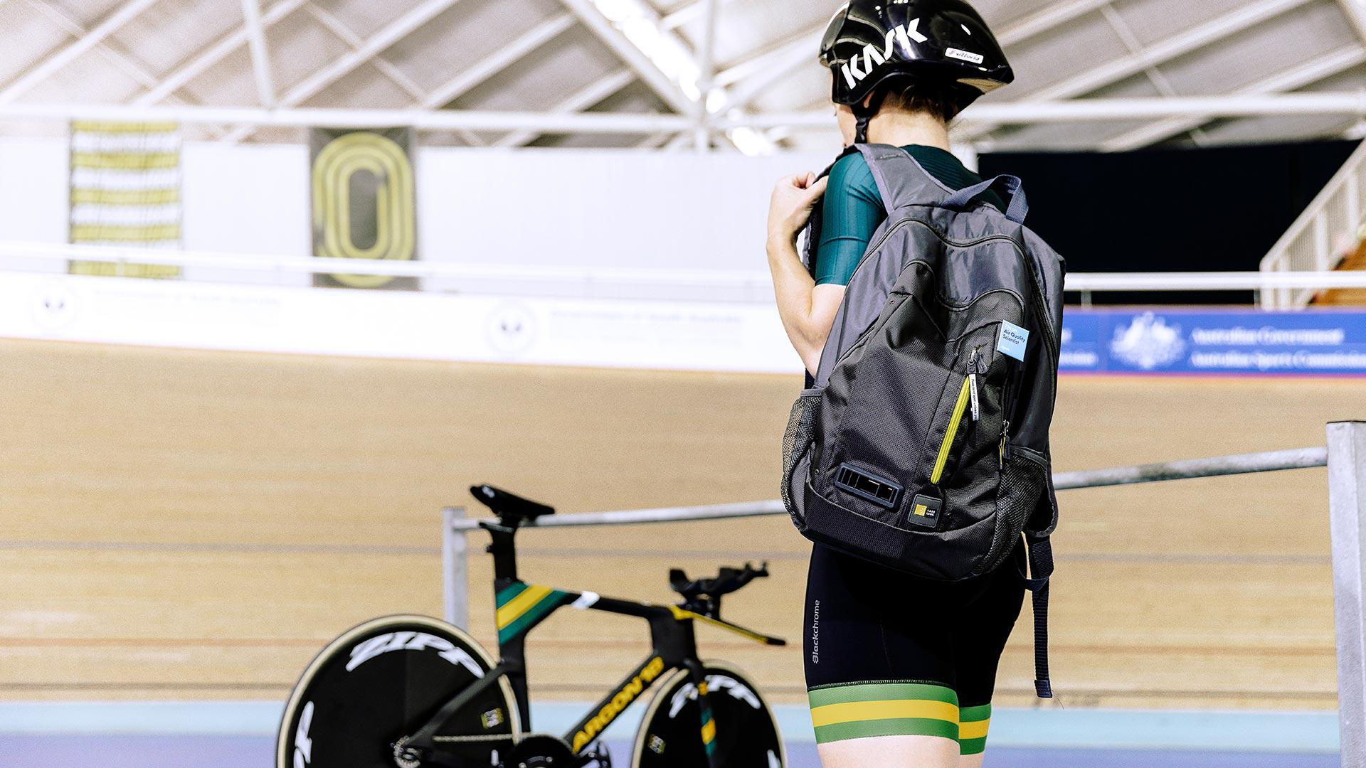 Annette Edmondson in veledrome with Dyson air quality backpack
