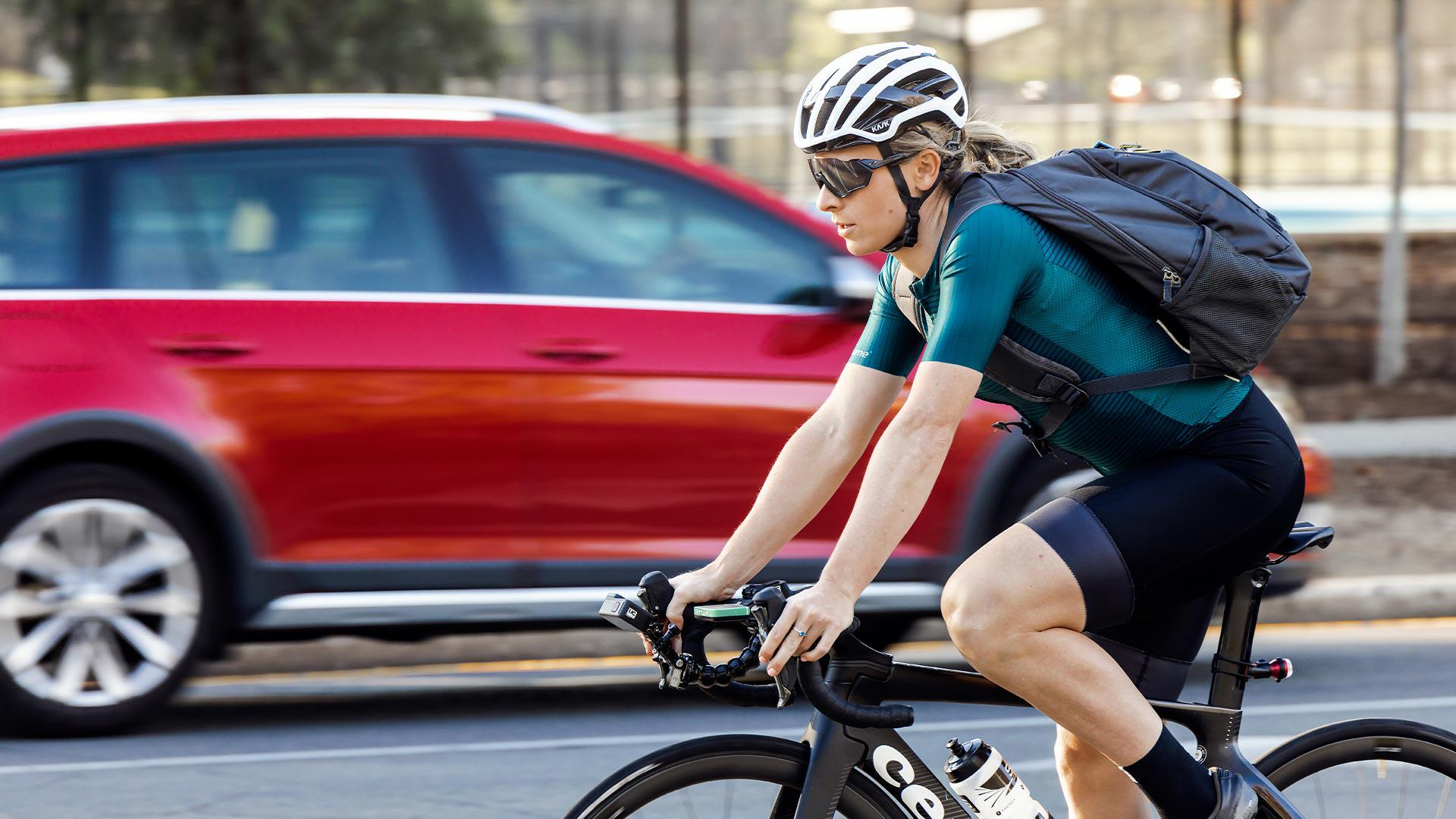 Annette Edmondson cycling with Dyson air quality backpack