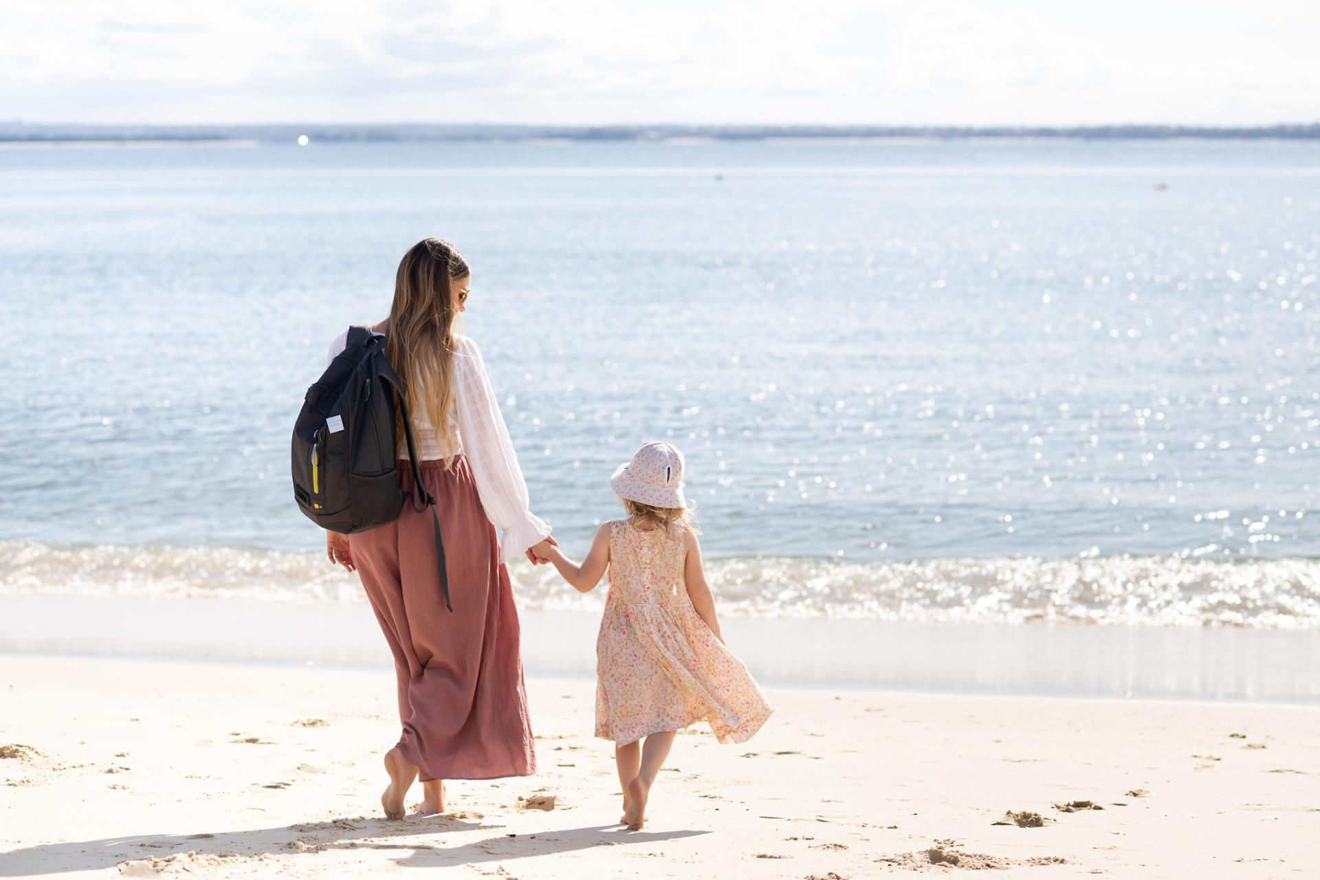 Leah walking on beach with family