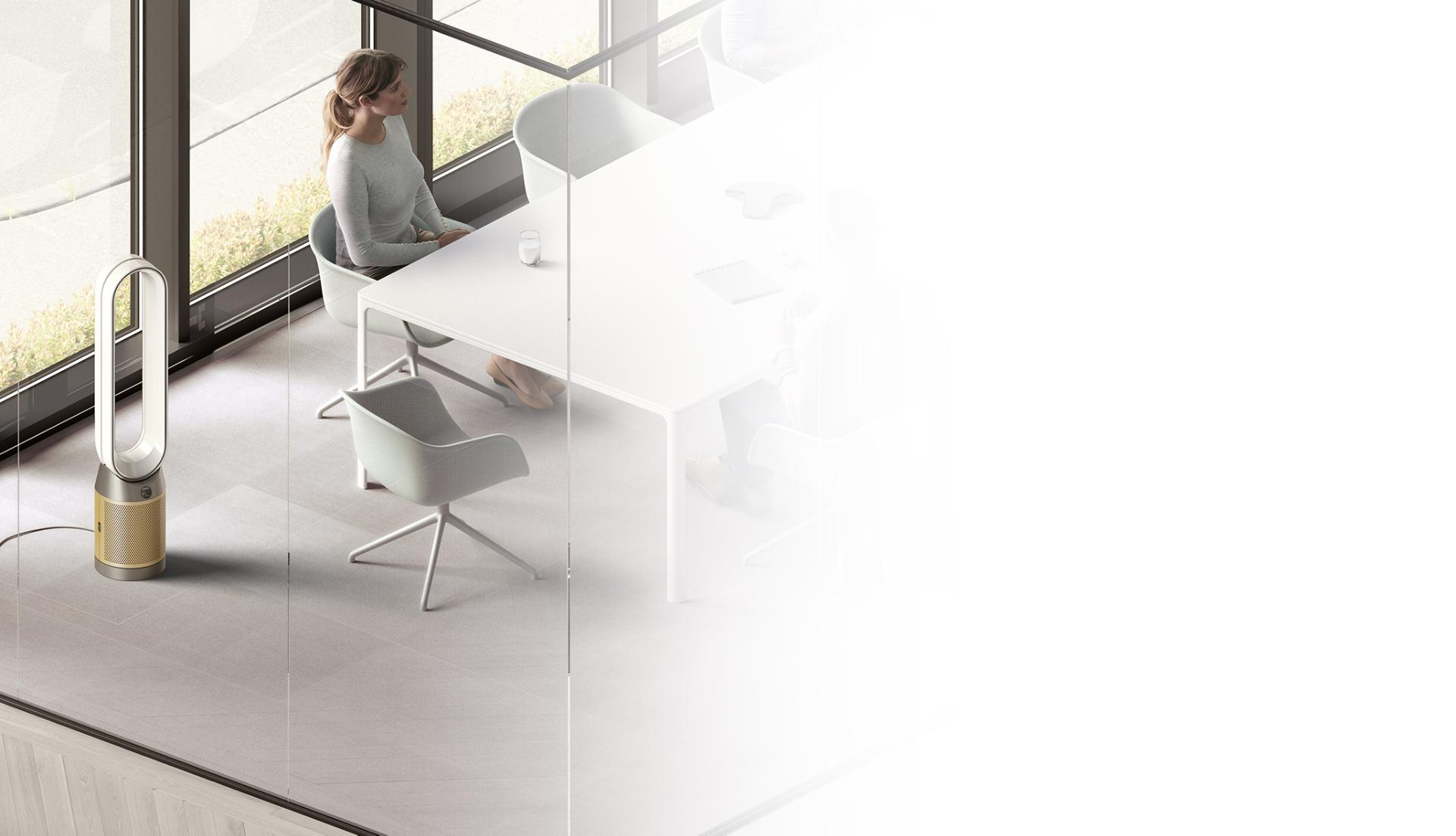 Dyson purifier sitting in corner of office space as meeting takes place