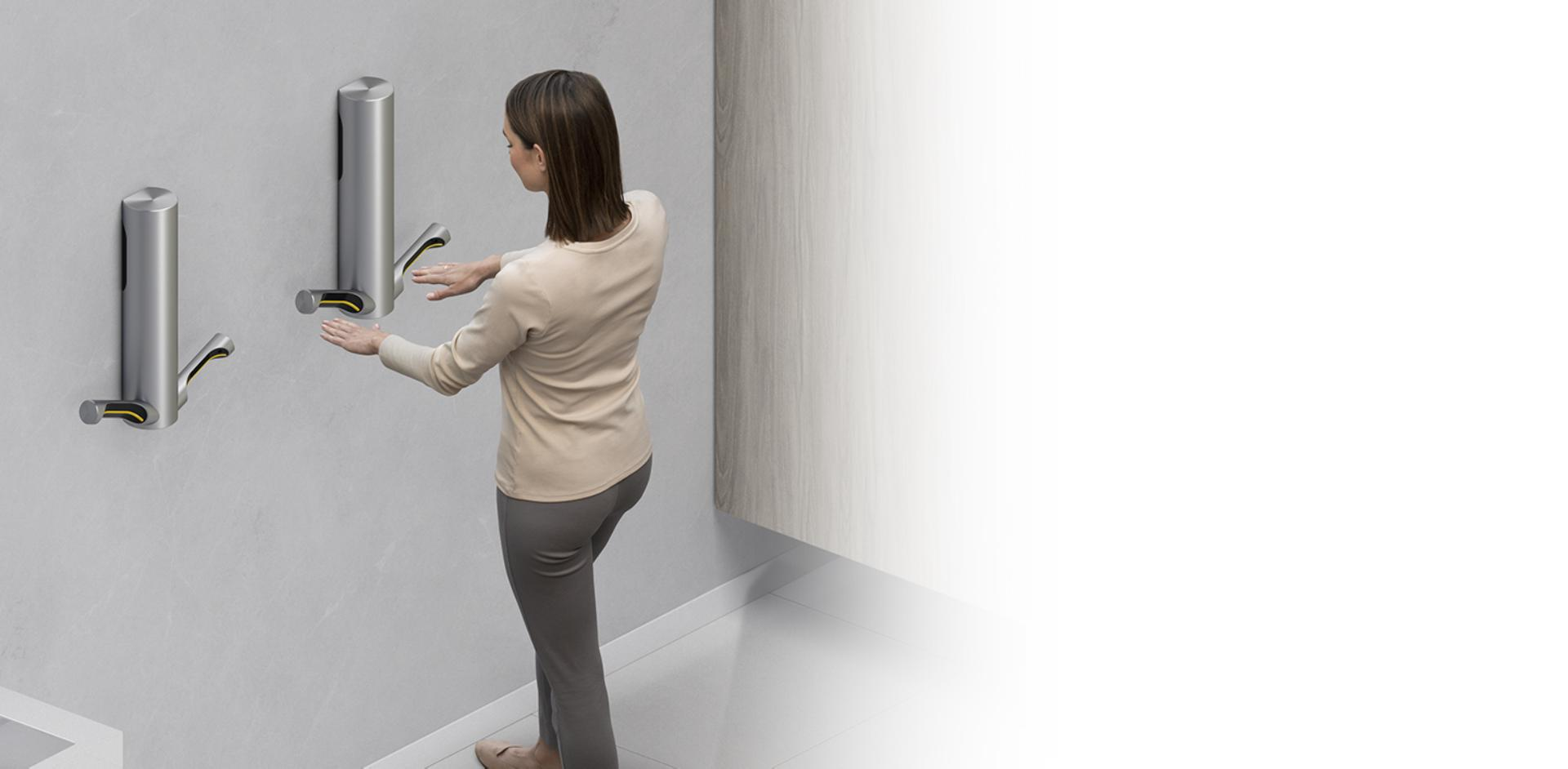 Woman drying hands with Dyson Airblade 9kJ