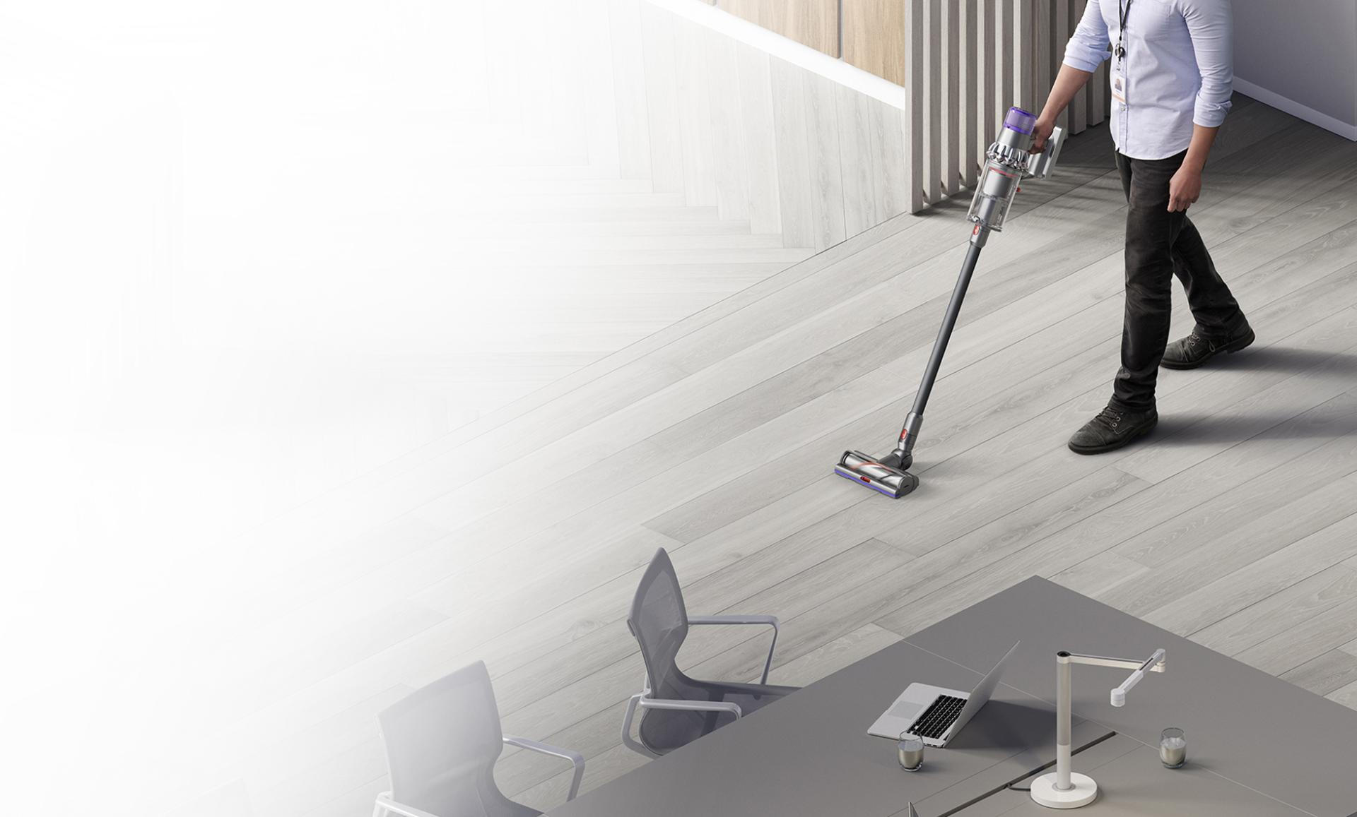 Man cleaning floor with Dyson V11 vacuum
