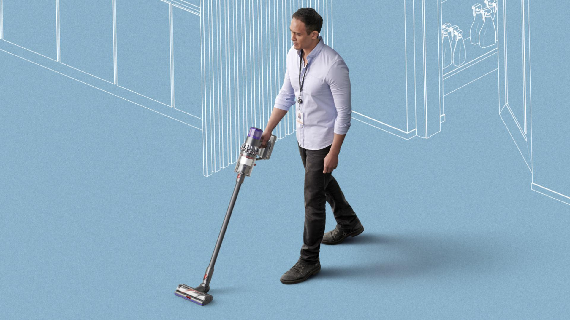 Man using Dyson cordless vacuum to clean floors