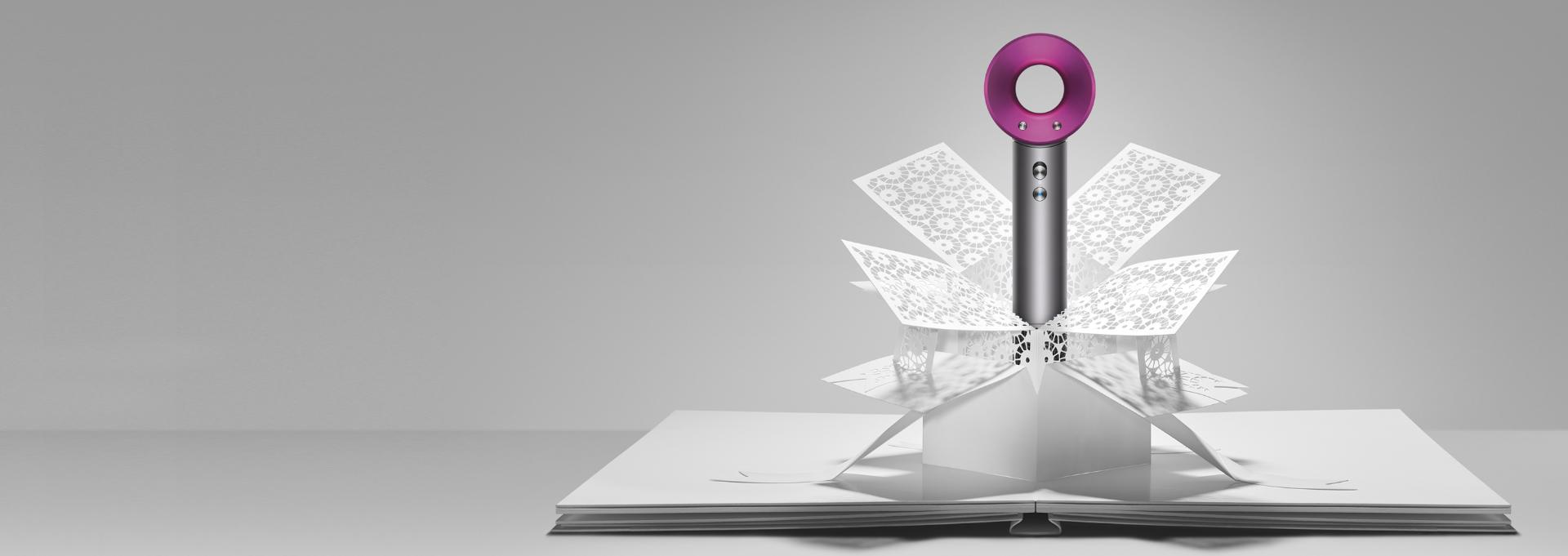 Dyson Supersonic™ hair dryer emerging from paper art