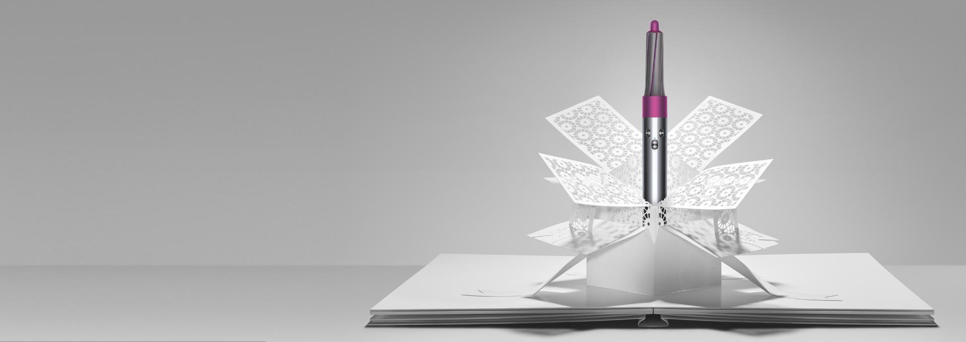 El estilizador Dyson Airwrap™ que emerge del arte en papel