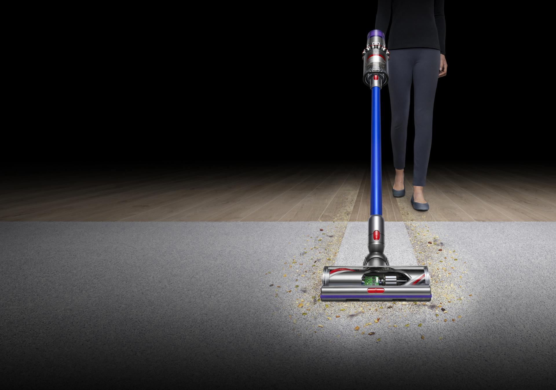Front view of Dyson V11™ vacuum on carpet