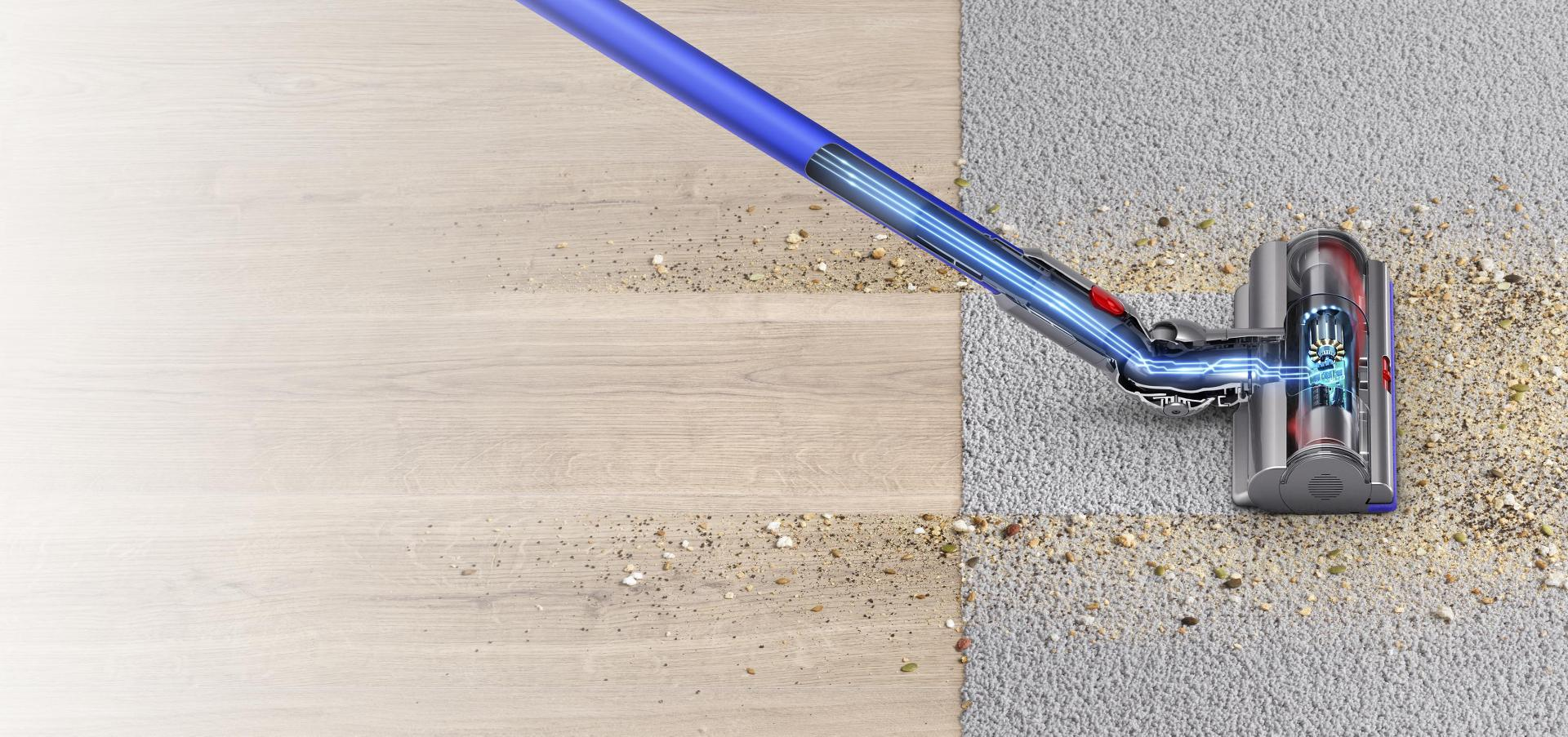 Dyson V11™ vacuum cleaner head moving from hard floor to carpet