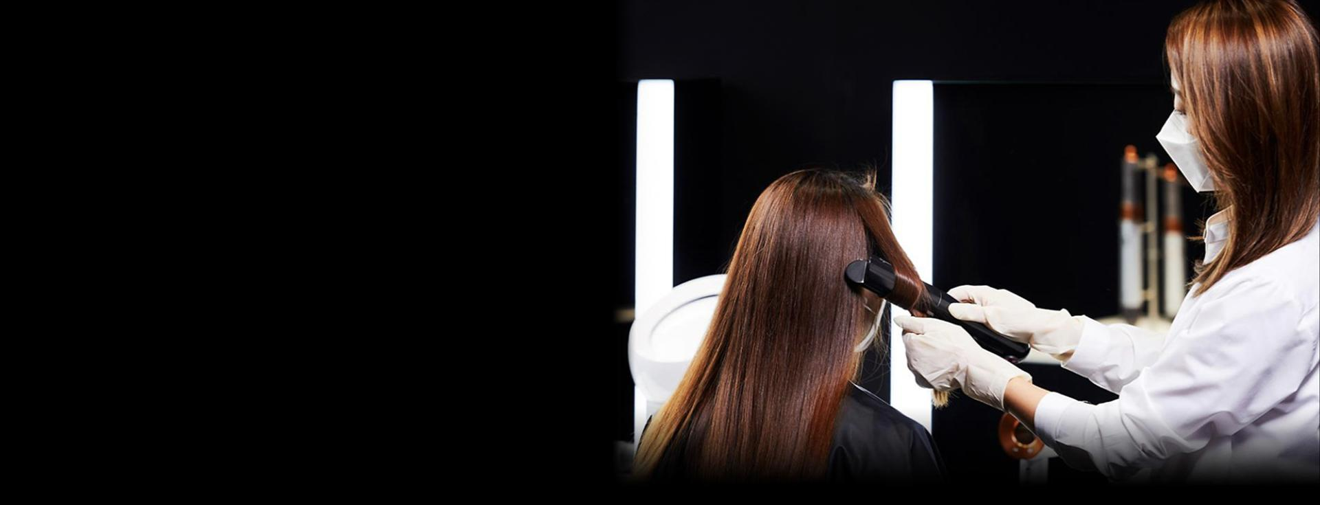 Woman having her hair styled with the Dyson Corrale