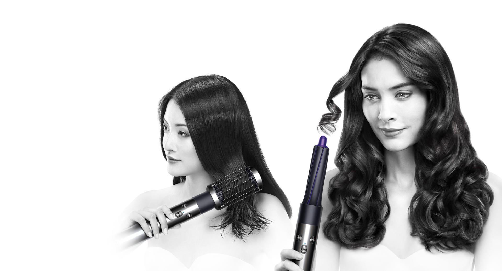 Photograph of two women using the Airwrap™️ styler.