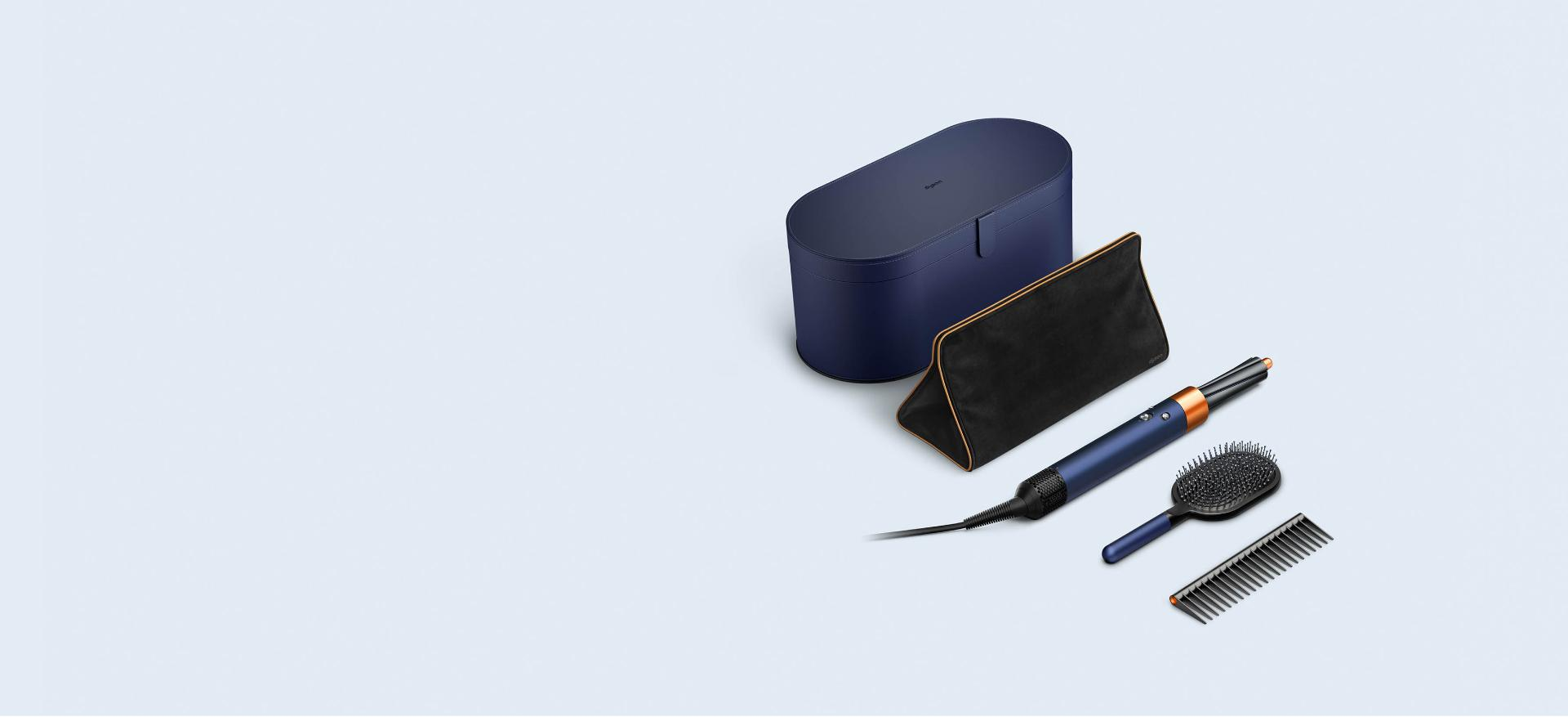 Dyson Airwrap styler and Supersonic hair dryer in Prussian blue and rich copper