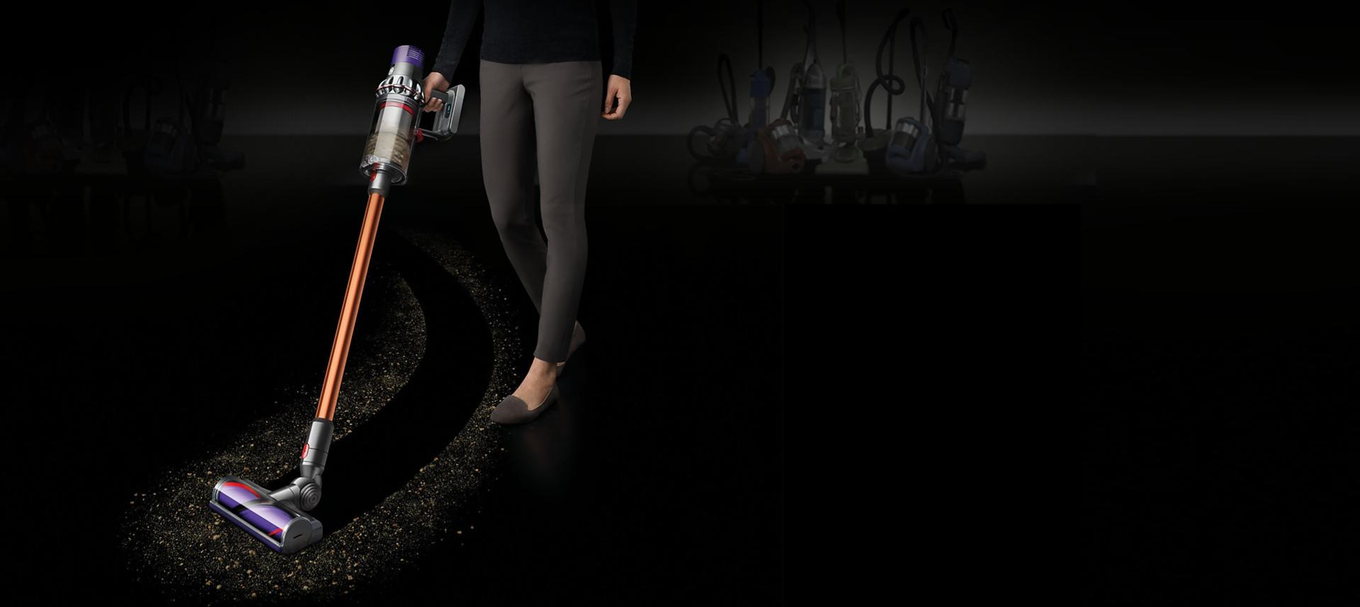 Dyson Cyclone V10™ vacuum cleaner on black floor