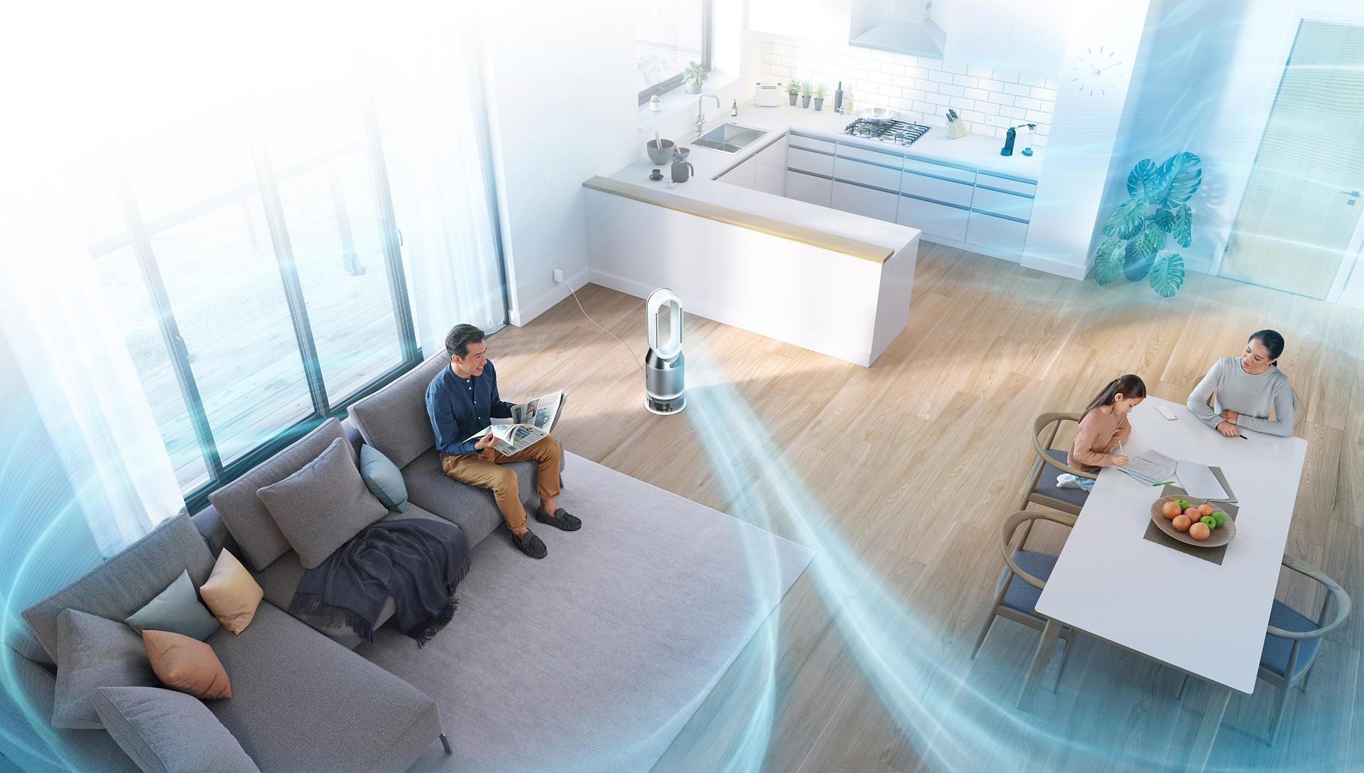 The Dyson purifier humidifier projecting air throughout a whole room while a family relax