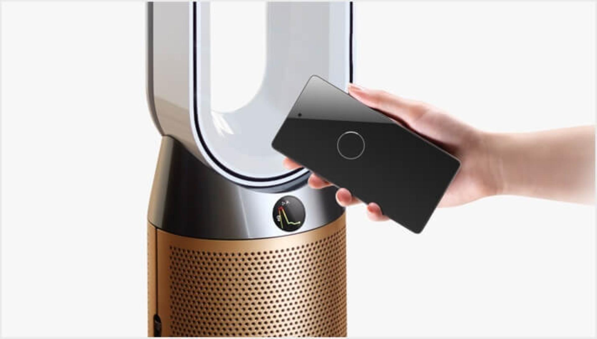Mobile device being held close to the Dyson Pure Cool Cryptomic air purifier