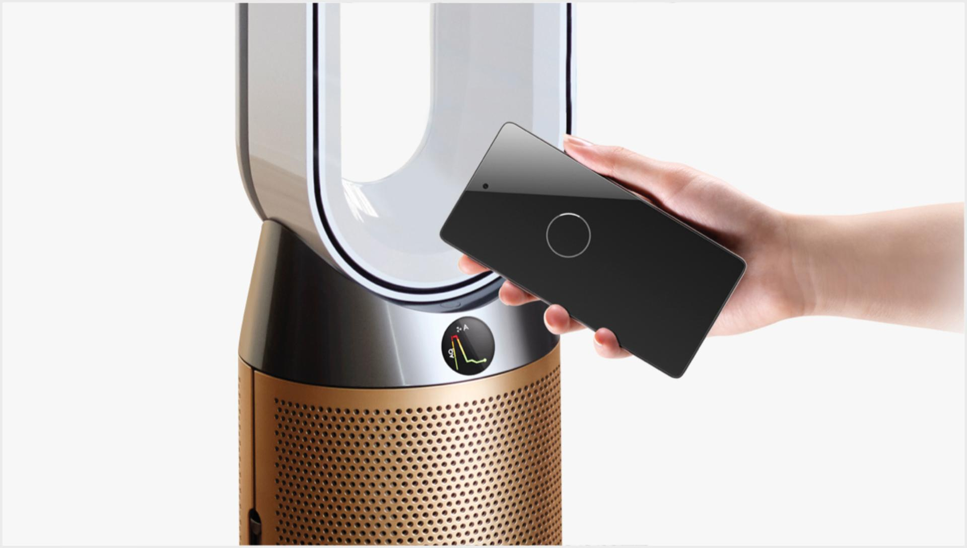 Phone held next to purifier