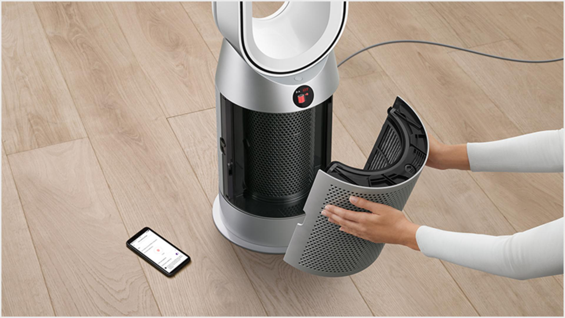 Someone changing a Dyson purifier's filter