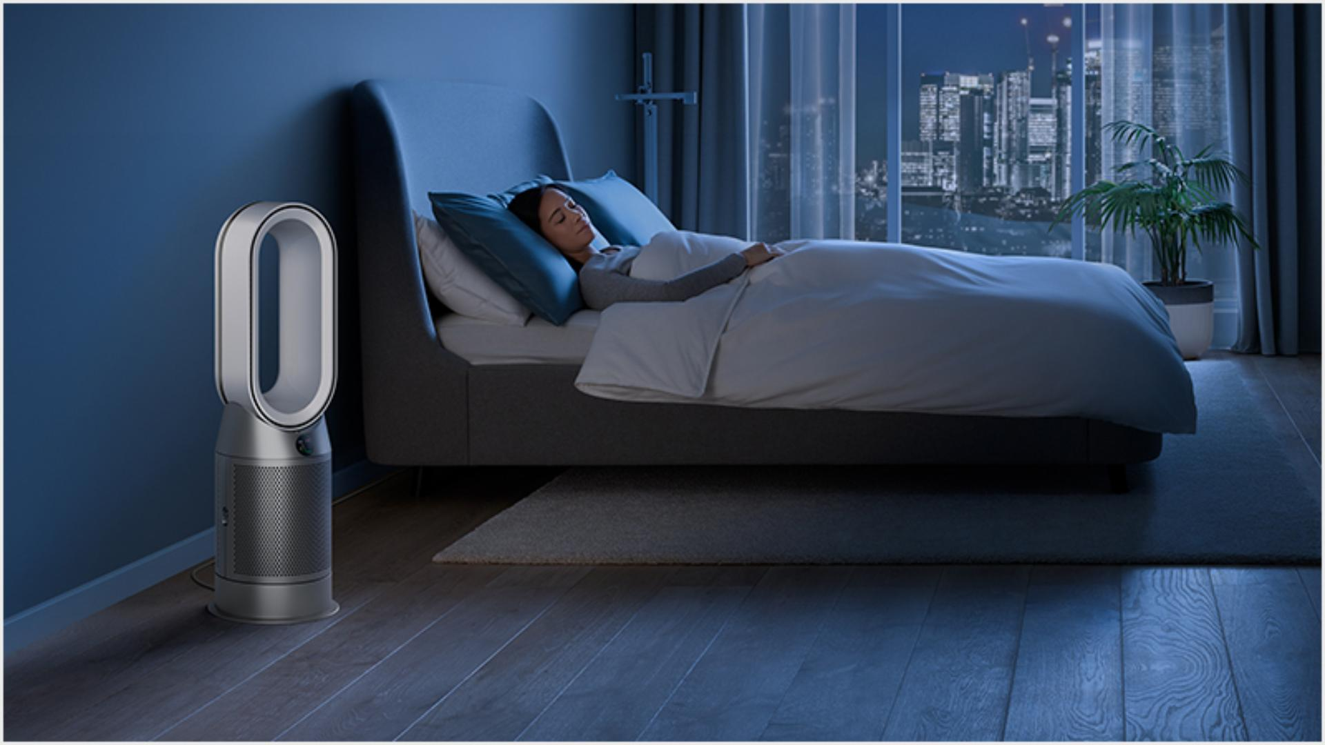 Someone sleeping peacefully in a hotel room purified by a Dyson purifier