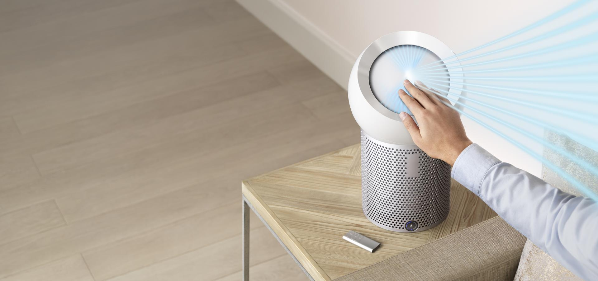 Hand reaching out to refocus airflow with Dyson Core Flow™ technology
