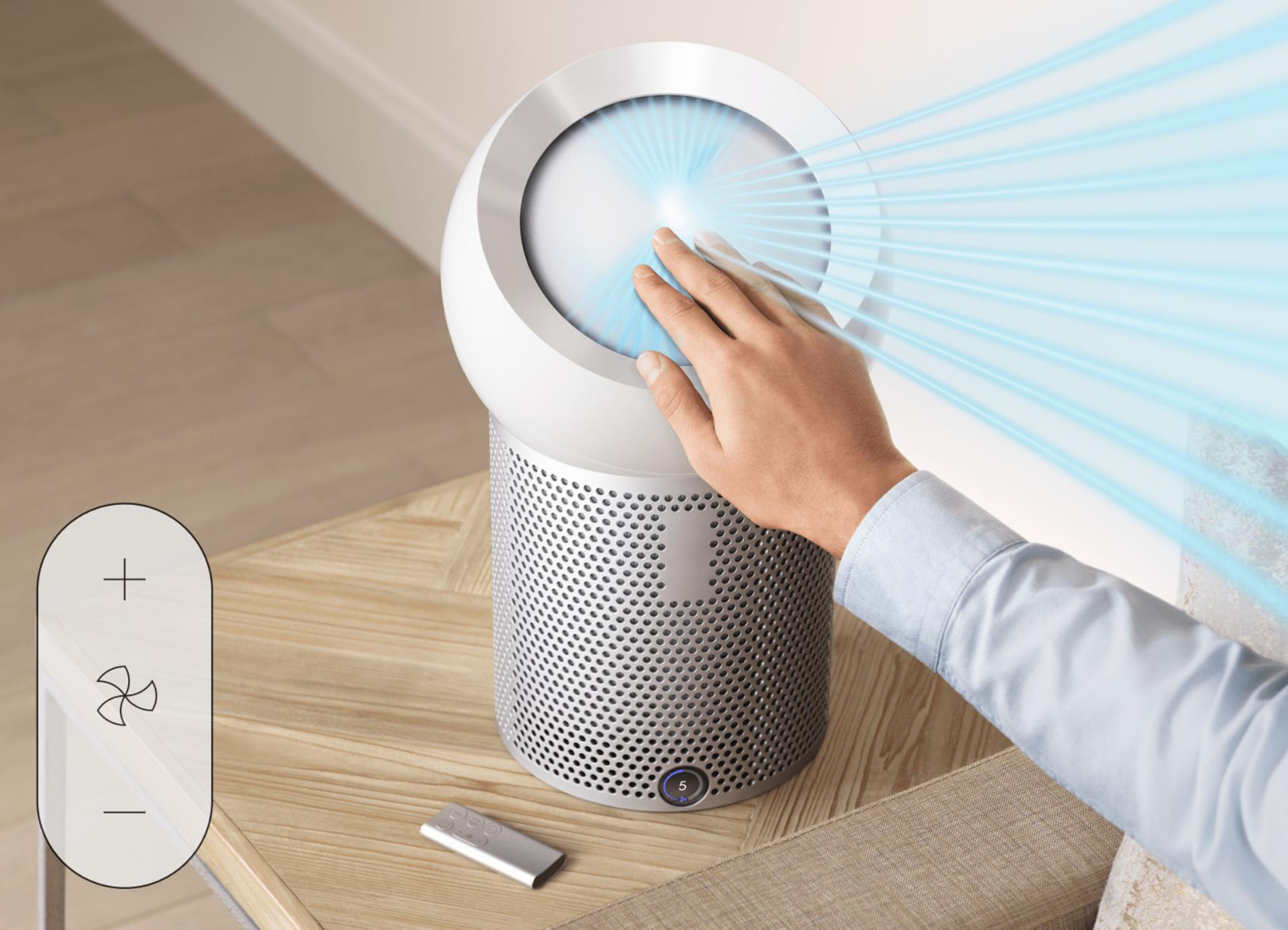 Hand reaching out to refocus airflow of Dyson Pure Cool Me™