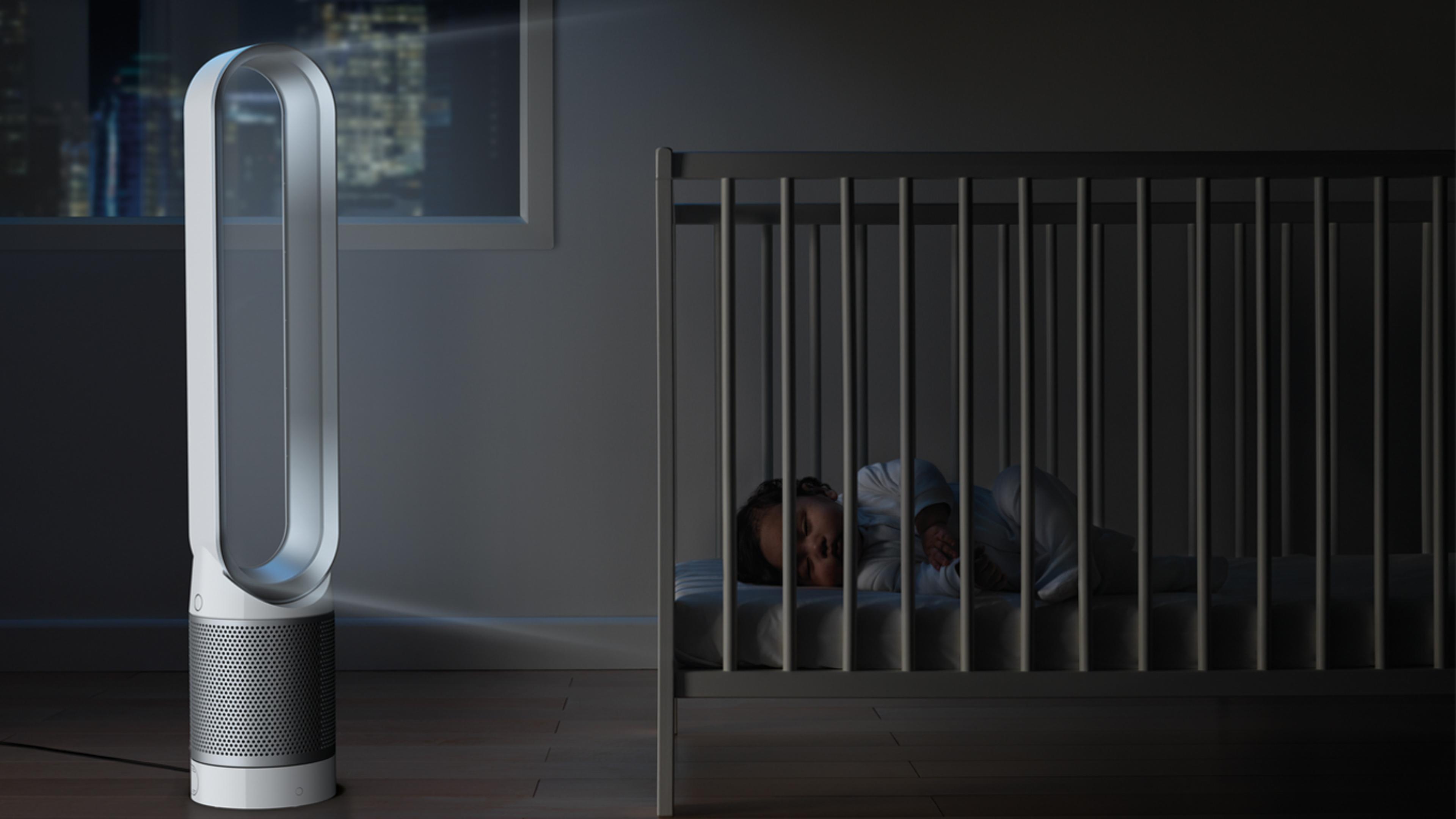 Dyson Pure Cool™ purifier fan in bedroom beside baby in cot