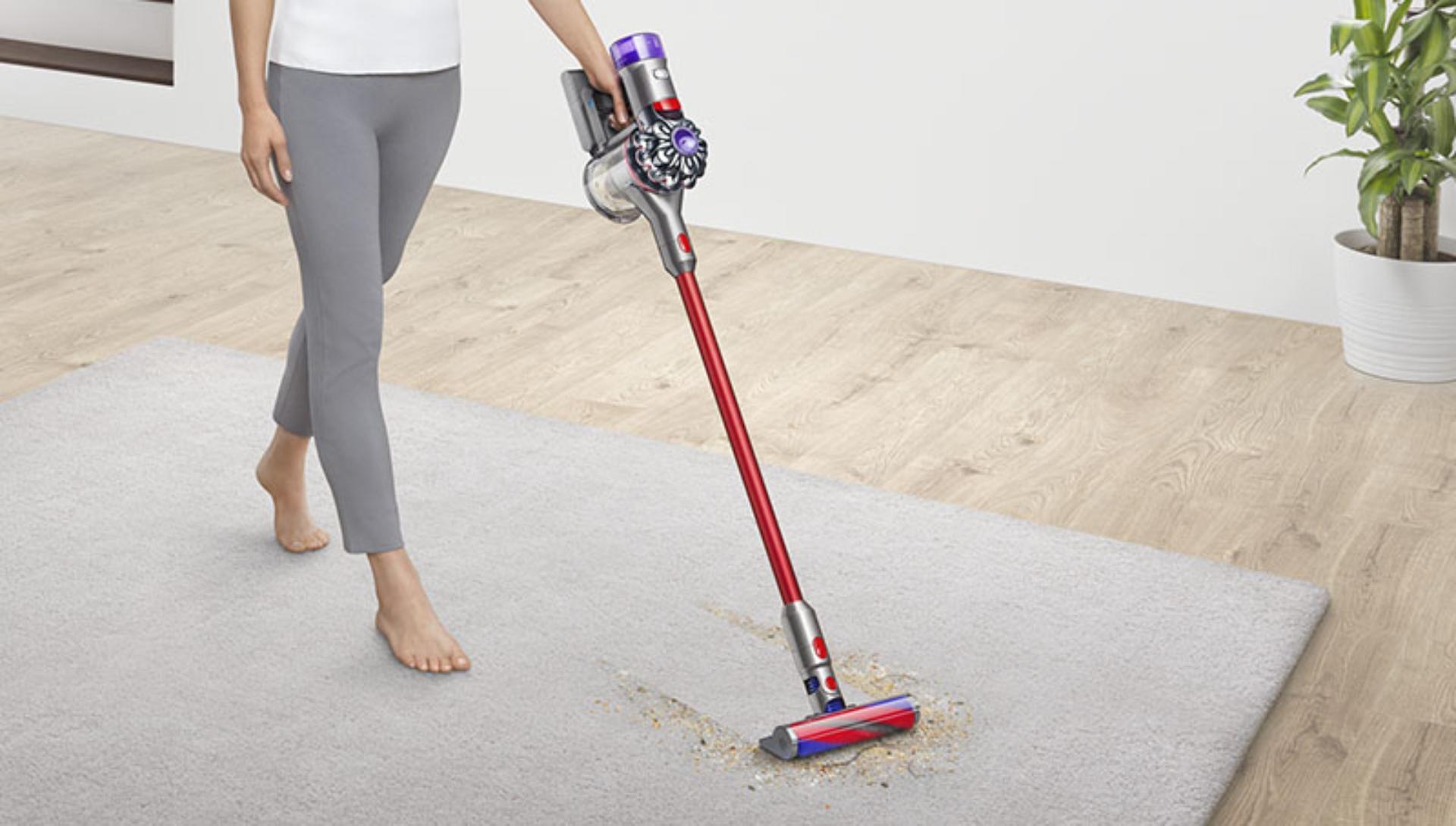 Dyson V8 slim being used on flooring