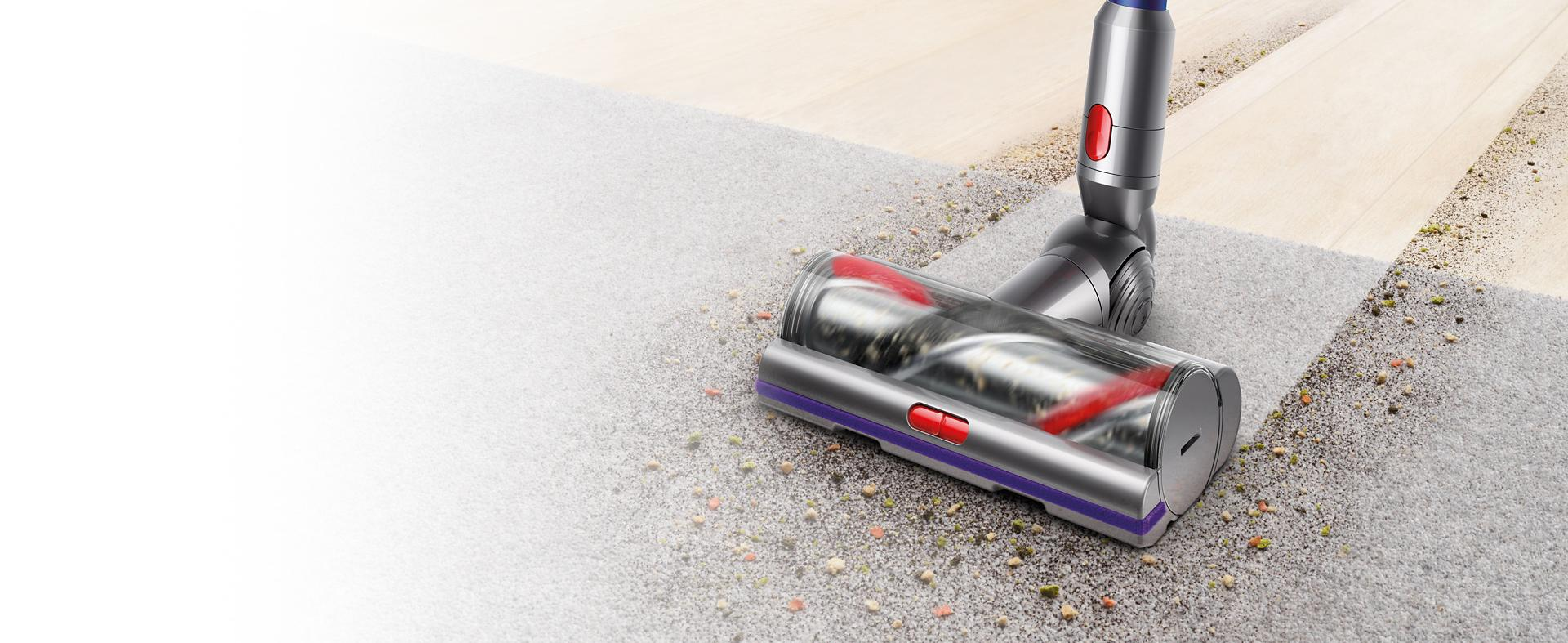 Dyson vacuum motorhead attachment cleaning hard floor then carpet.
