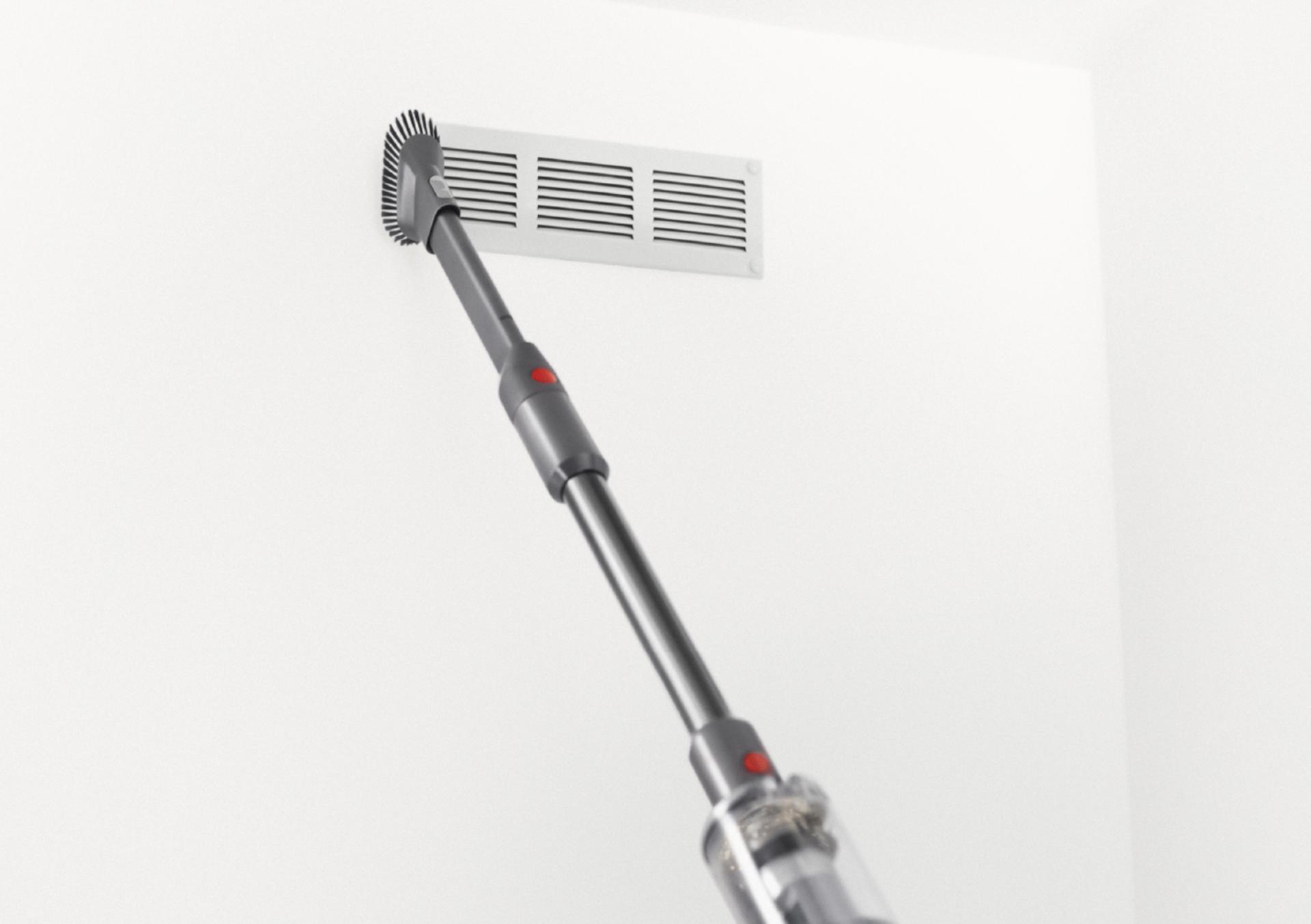 다이슨 옴니-글라이드™ 무선 청소기를 핸디 모드 전환해 벽 통풍구 청소하는 모습