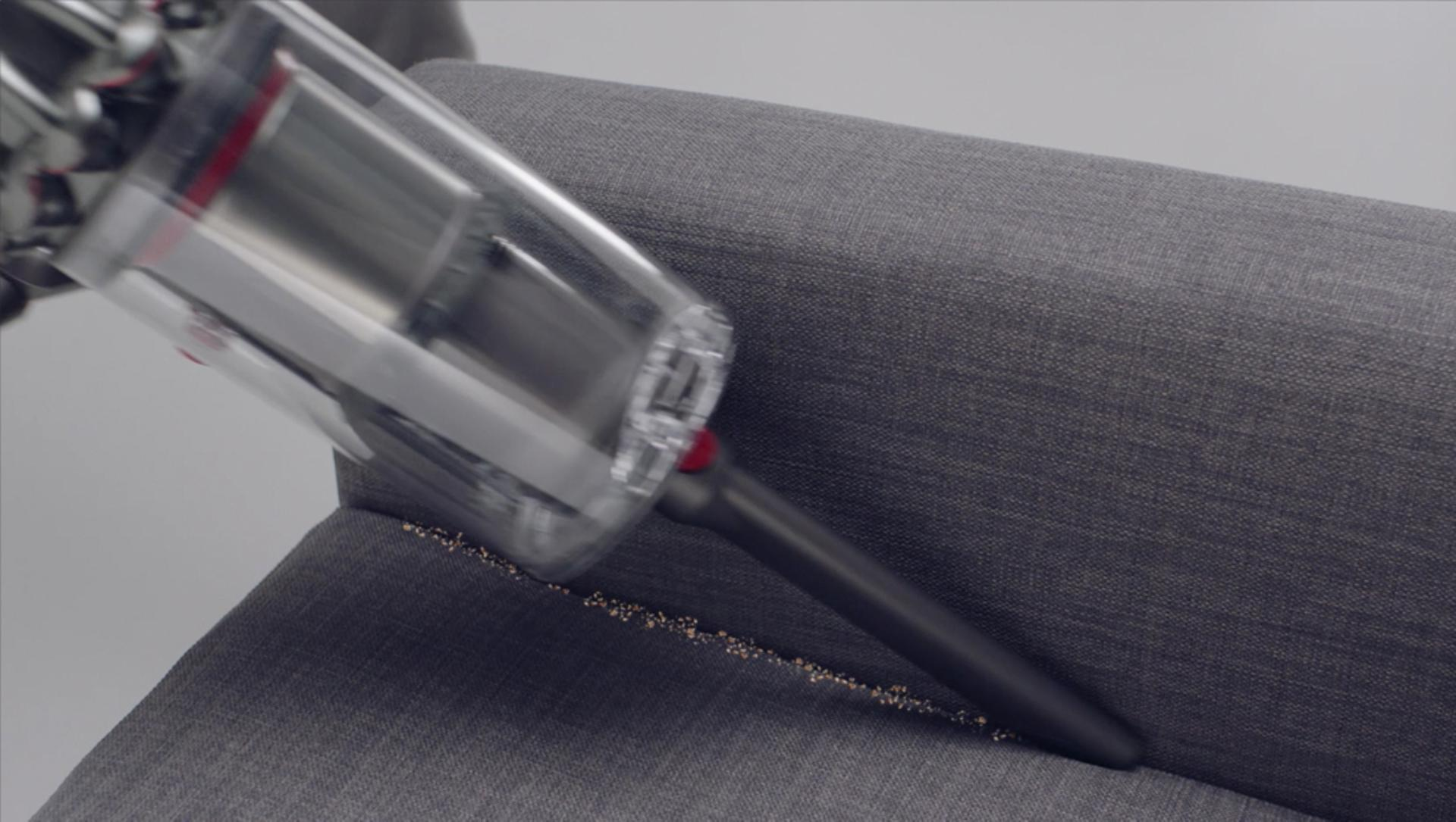 Crevice tool cleaning crevices of a sofa