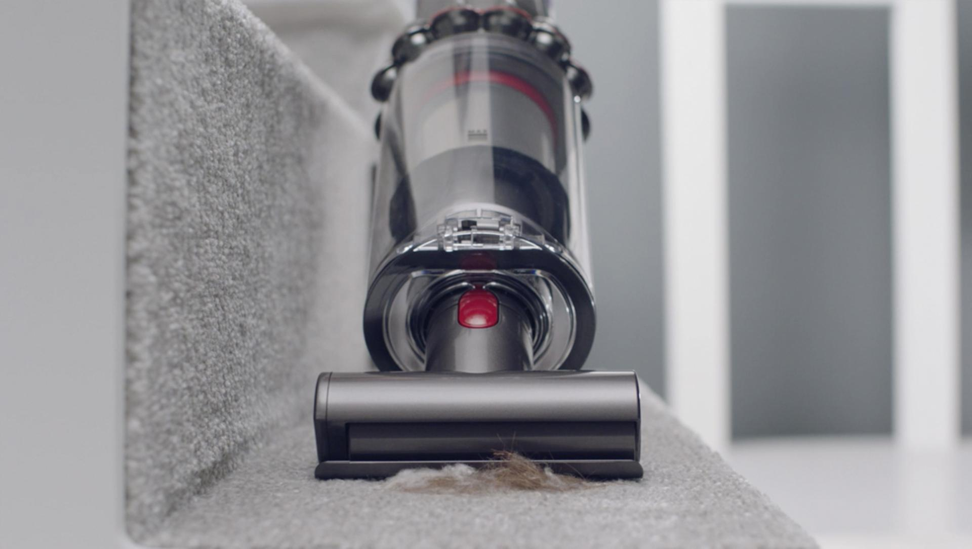 Mini motorised tool cleaning carpet on stairs