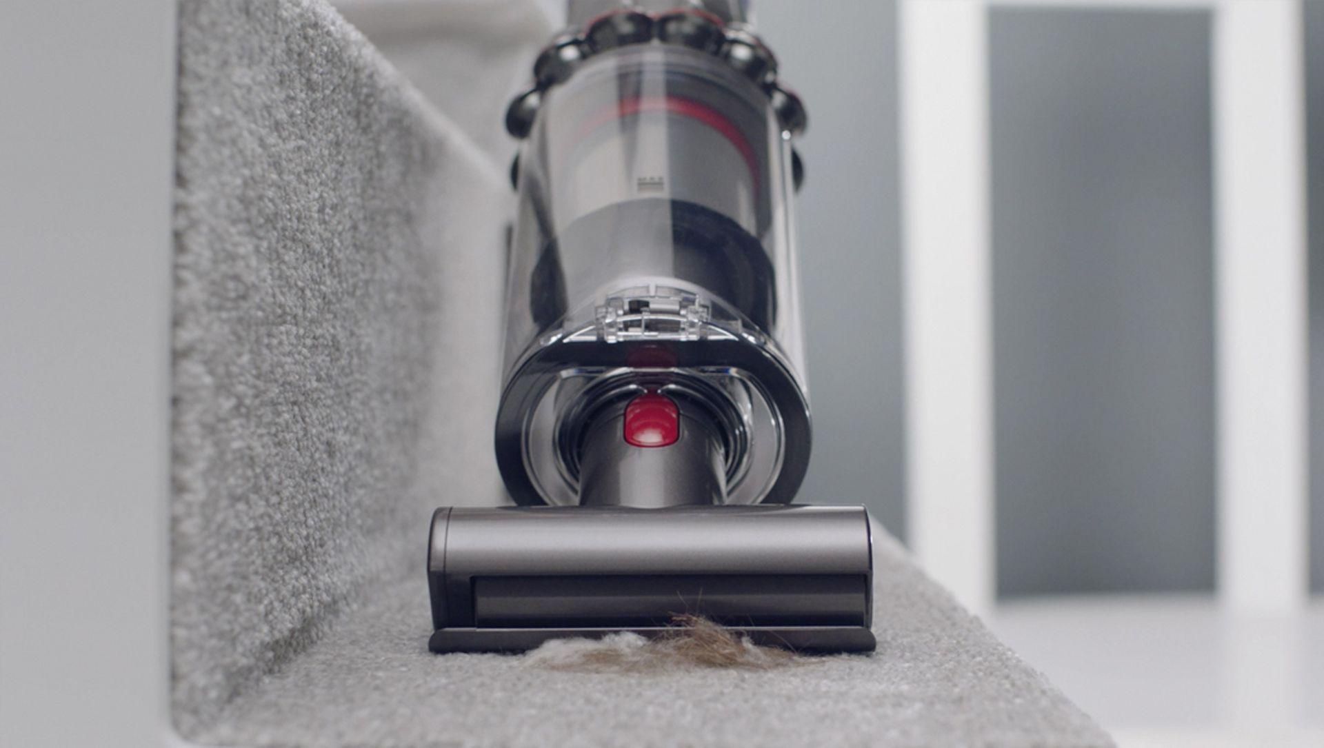 Mini motorised tool cleaning carpet on stairs