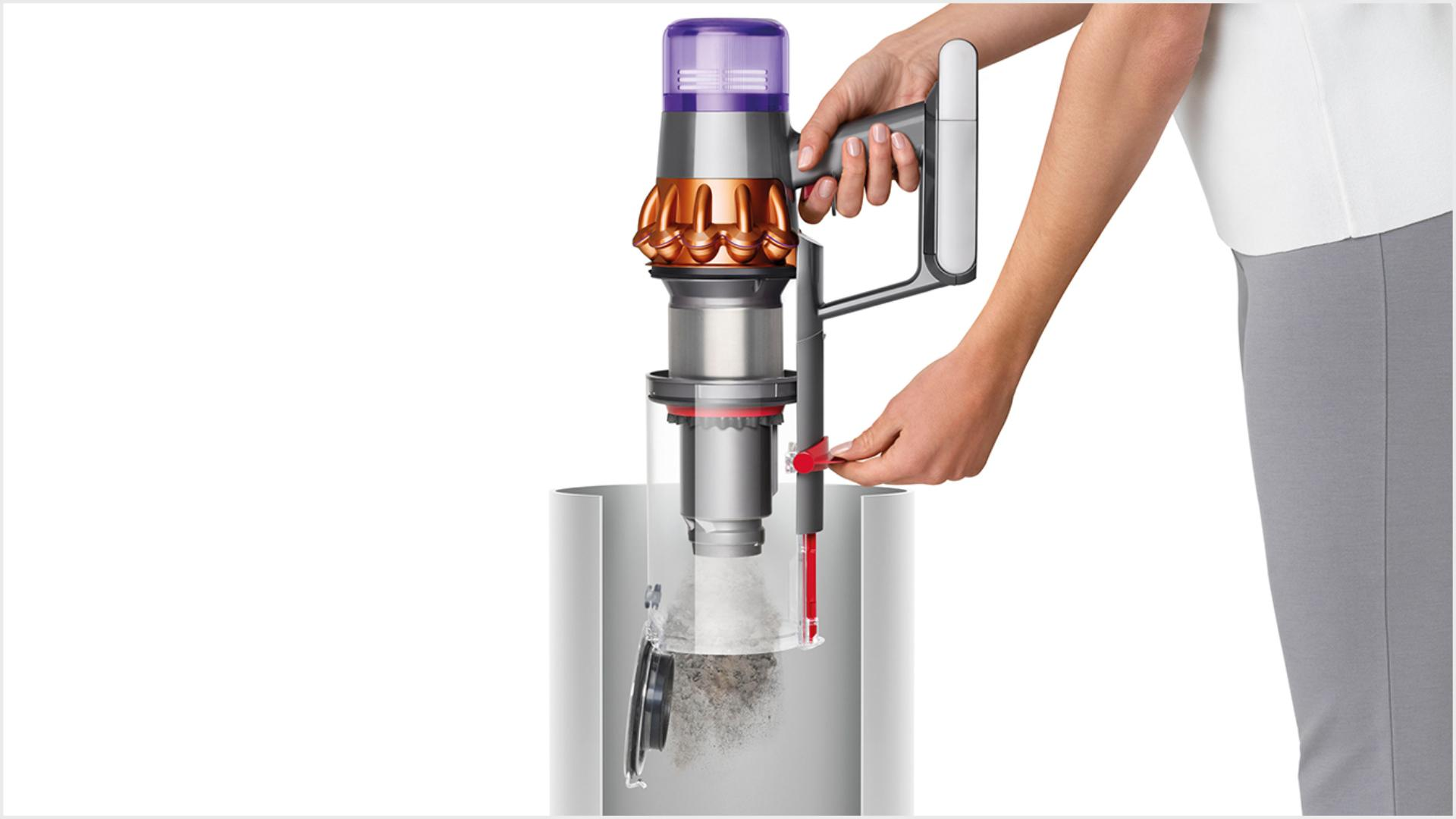 Woman emptying Dyson V11™ vacuum into bin