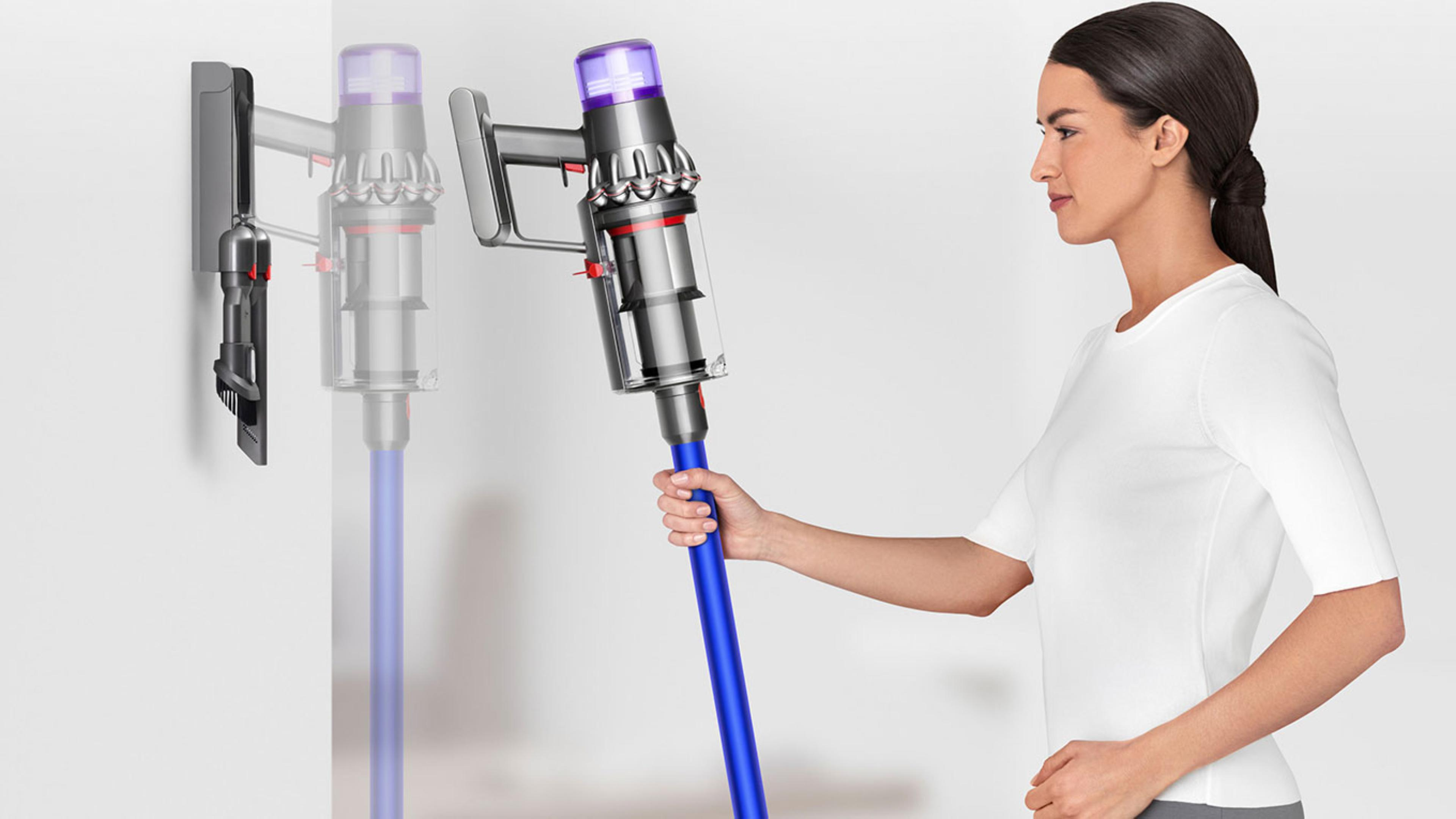 Dyson V11 vacuum cleaner being placed into wall mounted dock