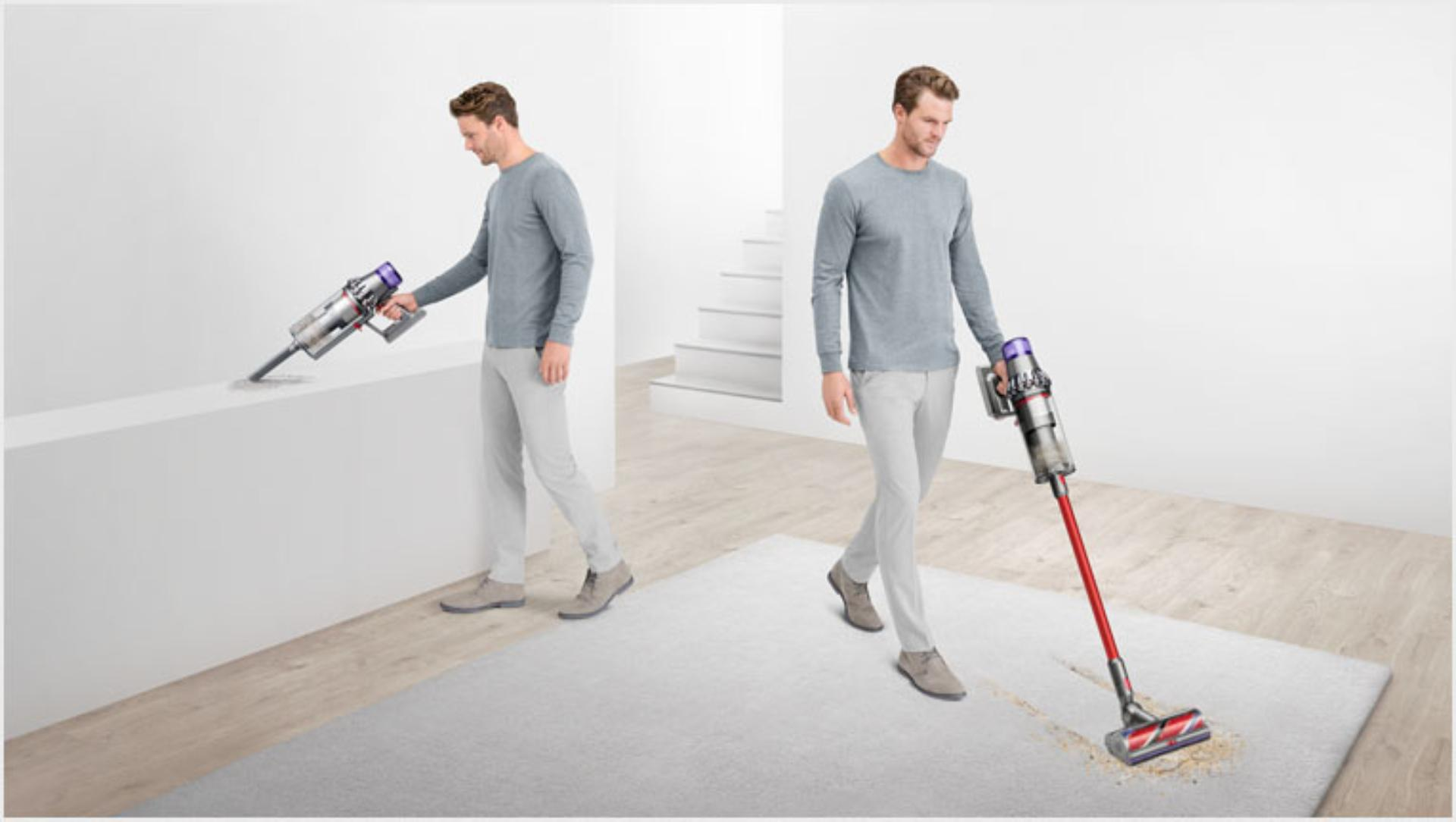 Man using the Dyson V11 Outsize vacuum as a stick and a handheld cleaner
