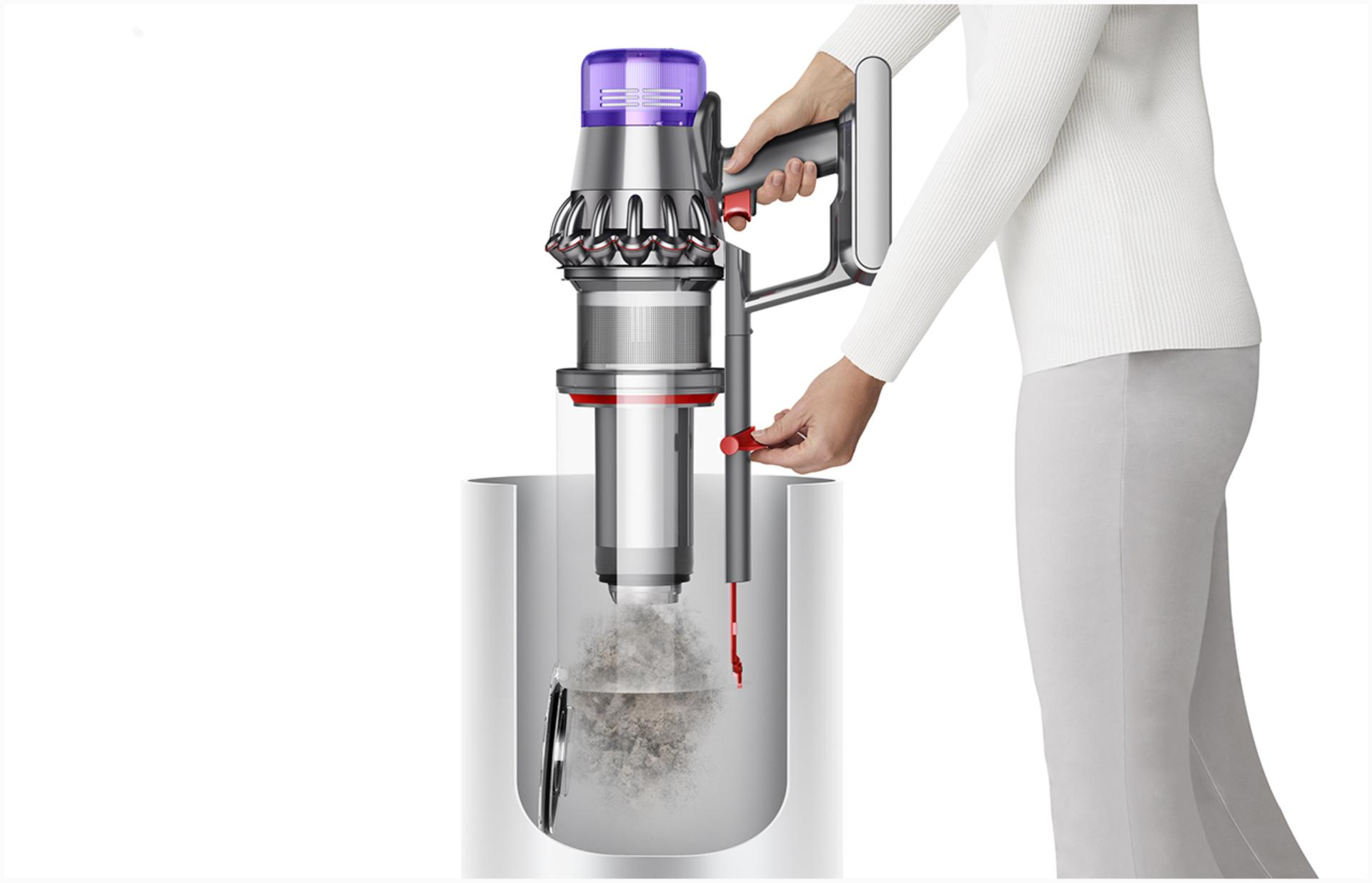 Woman emptying Dyson V11™ vacuum into bin