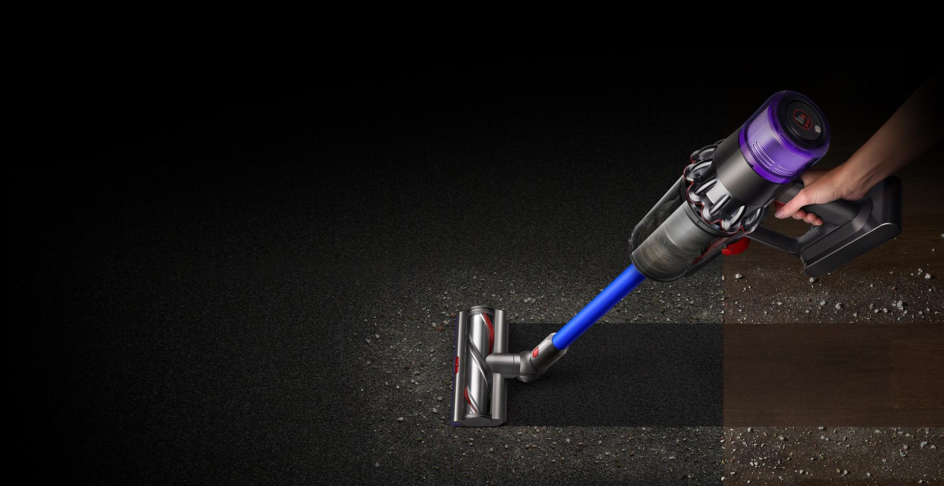 The Dyson V11™ vacuum cleaning across carpet and hard floor
